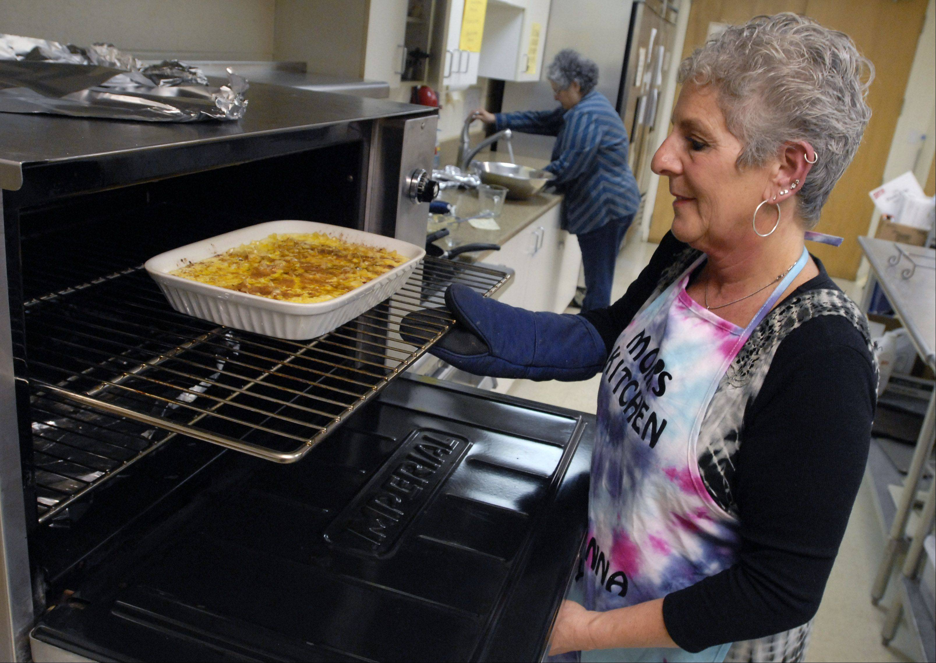 Cook of the Week Roberta Fahey puts her kugel in the oven at Beth Tikvah Early Childhood Center in Hoffman Estates where she cooks one dinner a week for students and teachers.