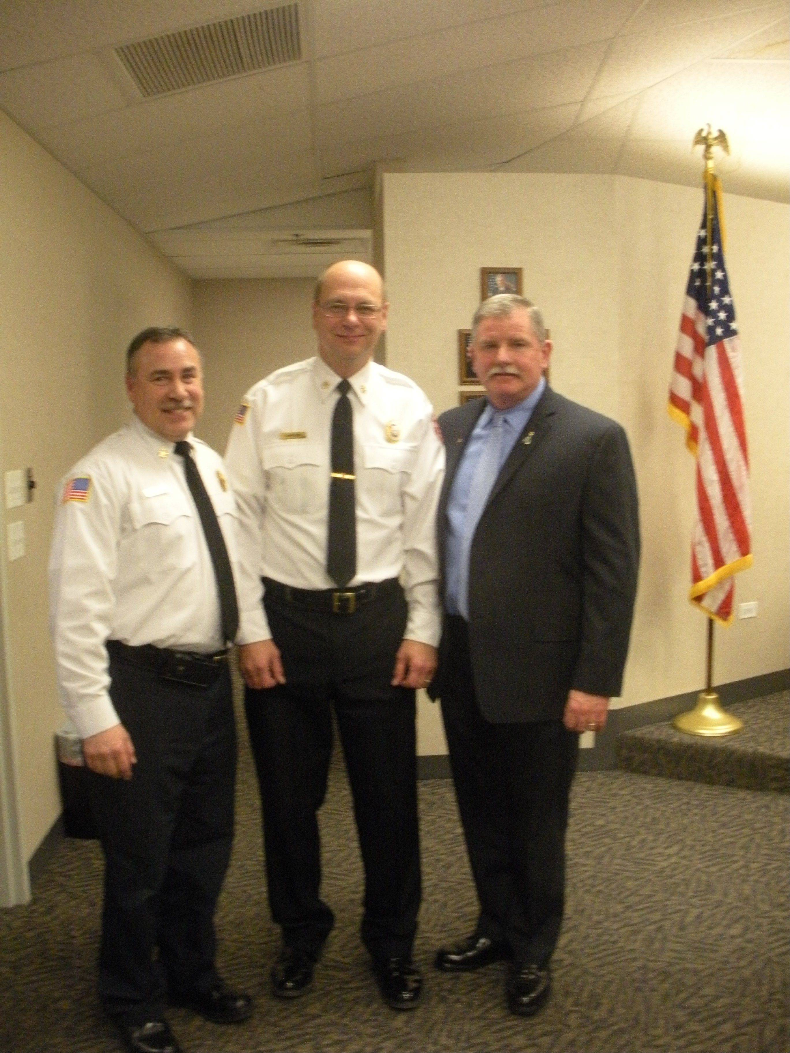 Carol Stream Fire Chief Rick Kolomay, from left, is joined by newly appointed Chief Administrative Officer Perry Johnson and newly appointed Deputy Chief Robert Hoff following the fire district board's approval of a leadership reorganization plan Monday night.