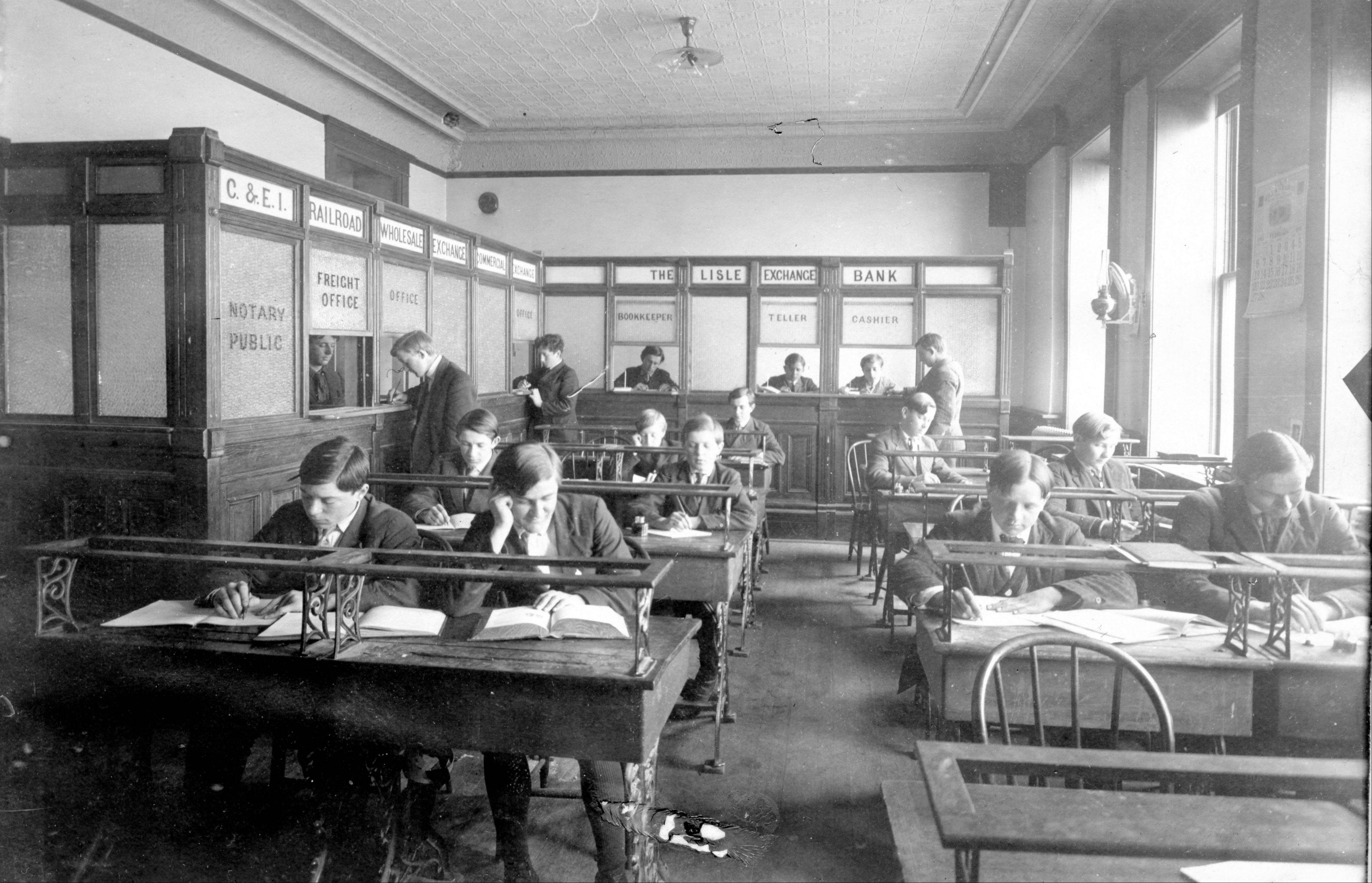 "Students study in a ""commercial study hall"" around 1909 at St. Procopius Academy, which became Benet Academy. The institution celebrates its 125th anniversary March 2."