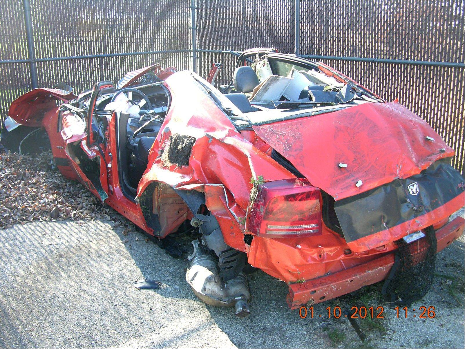 "Police said an ""event data recorder"" showed that this 2008 Dodge Charger was traveling 142 mph when it crashed last month on Ogden Avenue in Naperville. The driver survived and is facing charges."