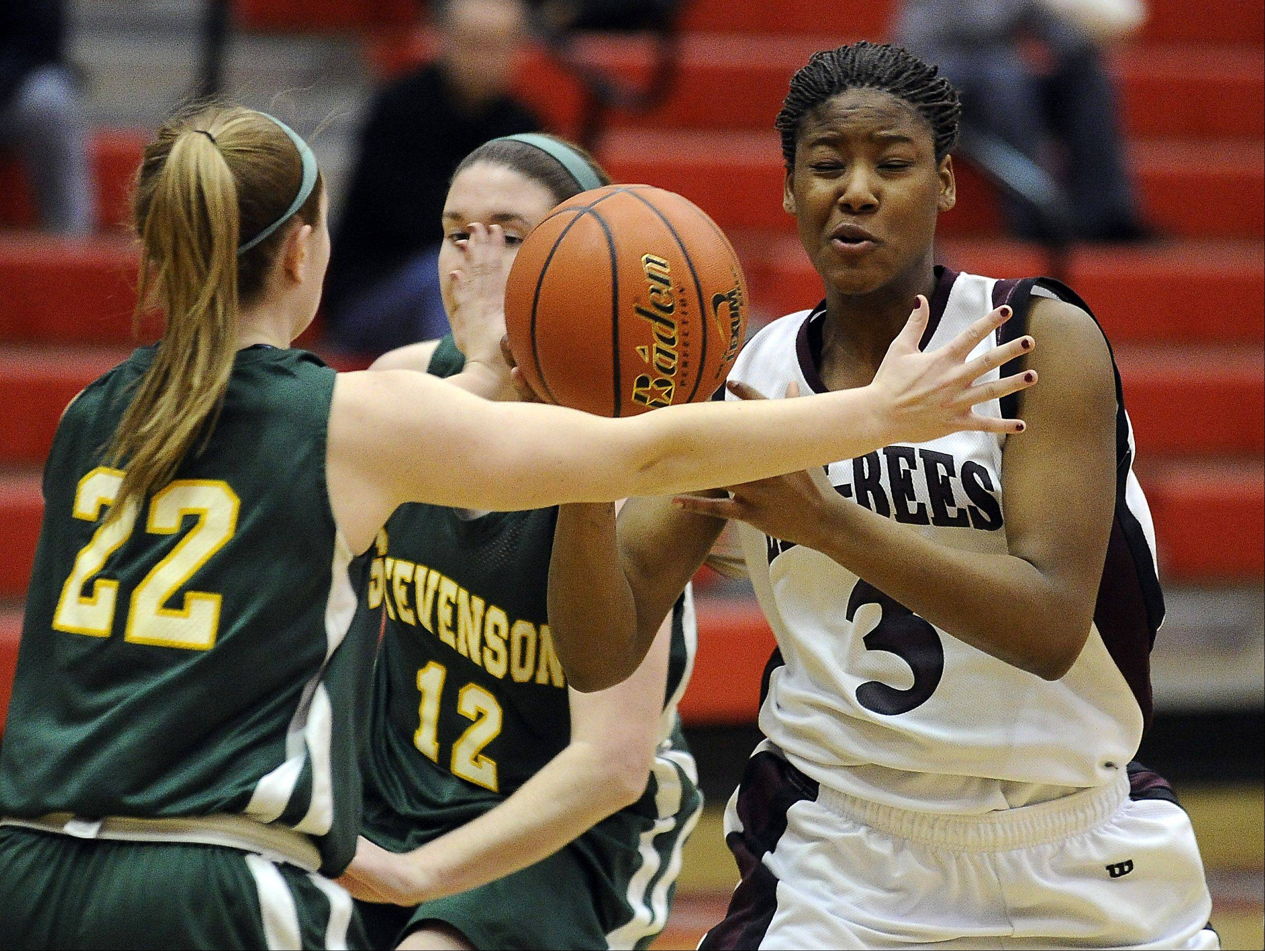 Stevenson's Katherine Moffat knocks the ball loose from Zion-Benton's Octavia Crump during Monday's sectional basketball game at Palatine High School.