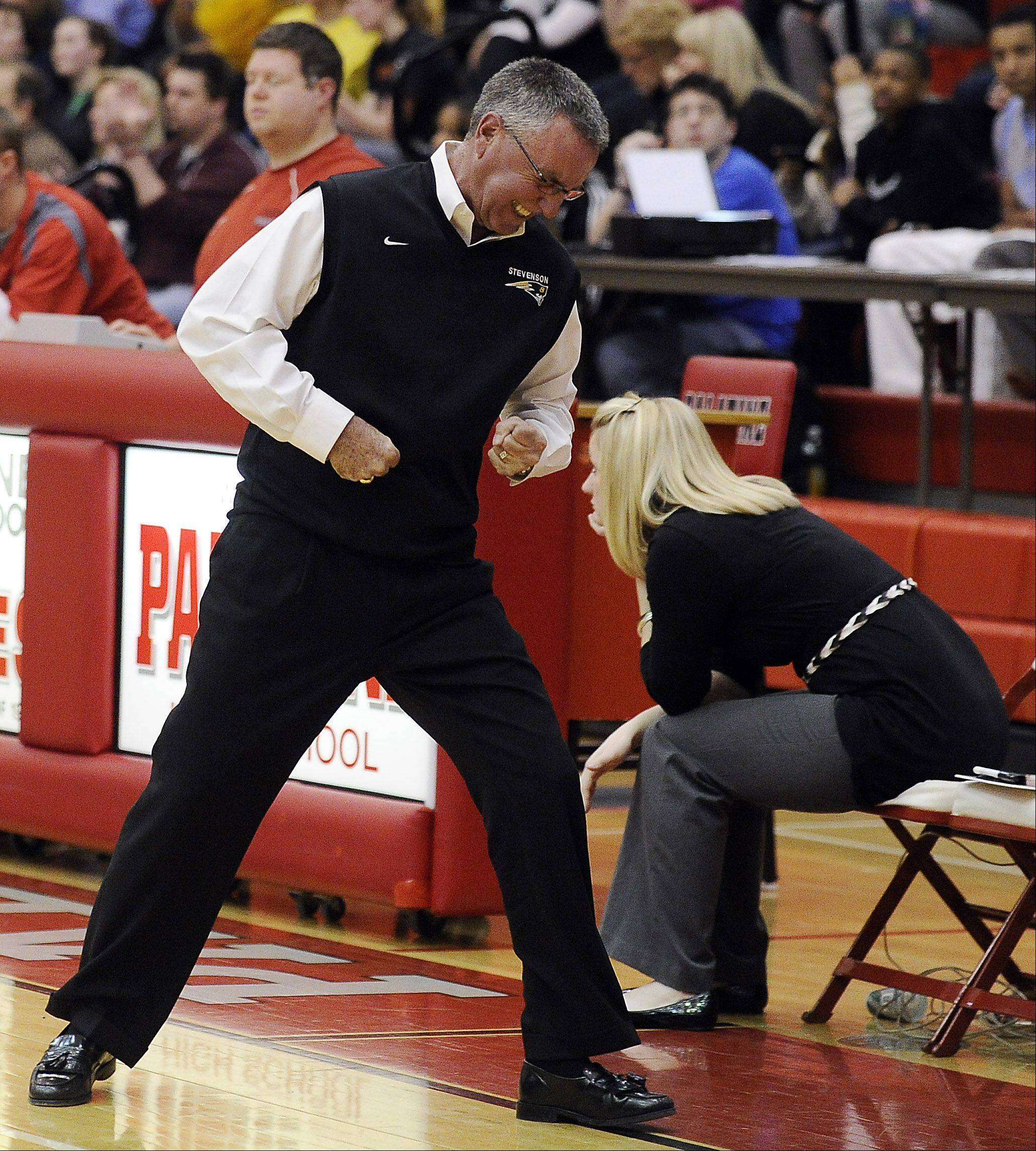 Stevenson coach Tom Dineen shows his frustration on a missed opportunity as his team falls to Zion-Benton's in Monday's sectional basketball game in Palatine.