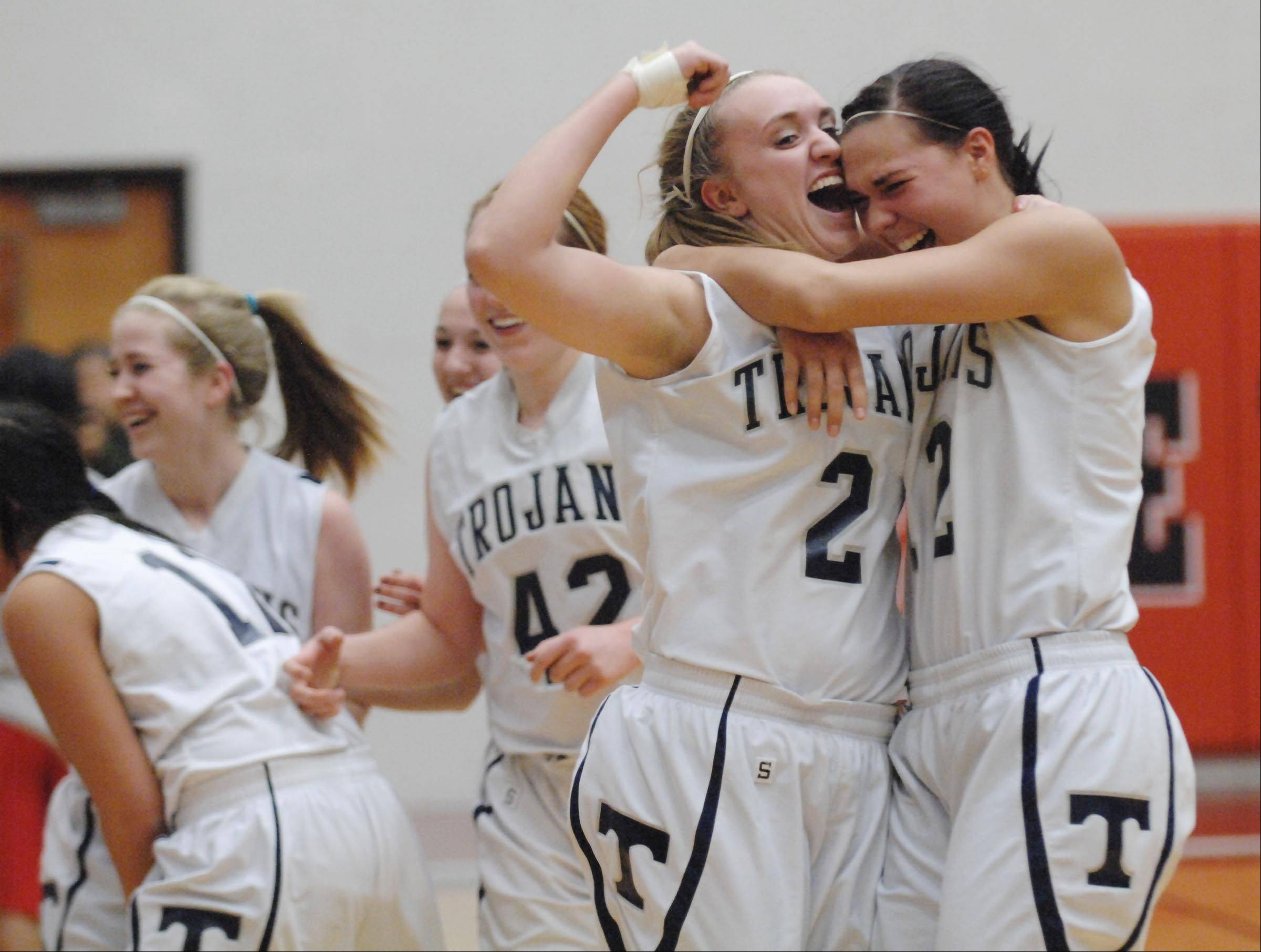 Cary-Grove's Katie Barker and Joslyn Nicholson, right, celebrate their win against South Elgin at Tuesday's McHenry sectional game.