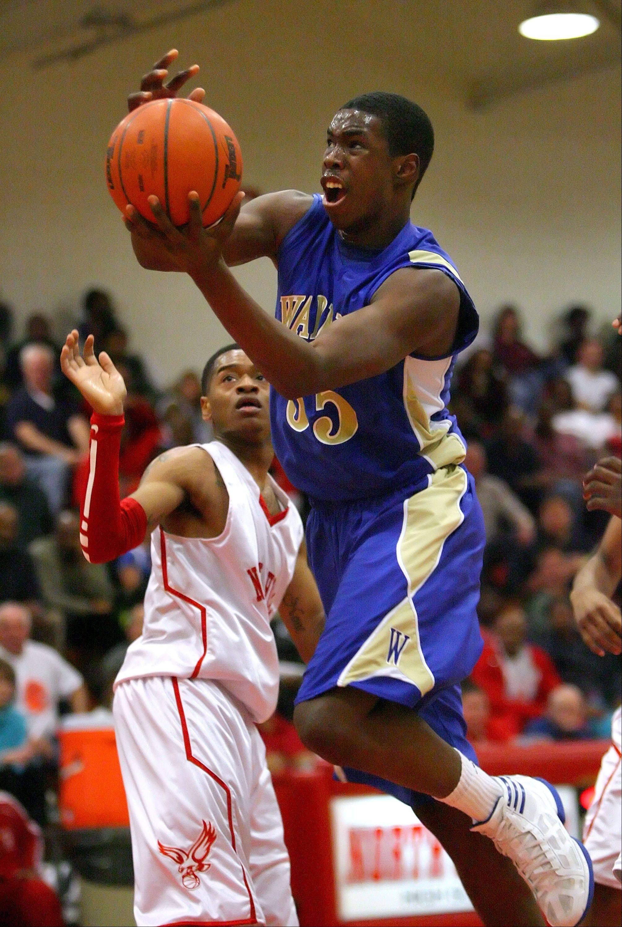 Warren's Darius Paul, right, drives past North Chicago's Aaron Simpson during Wednesday's game in North Chicago.