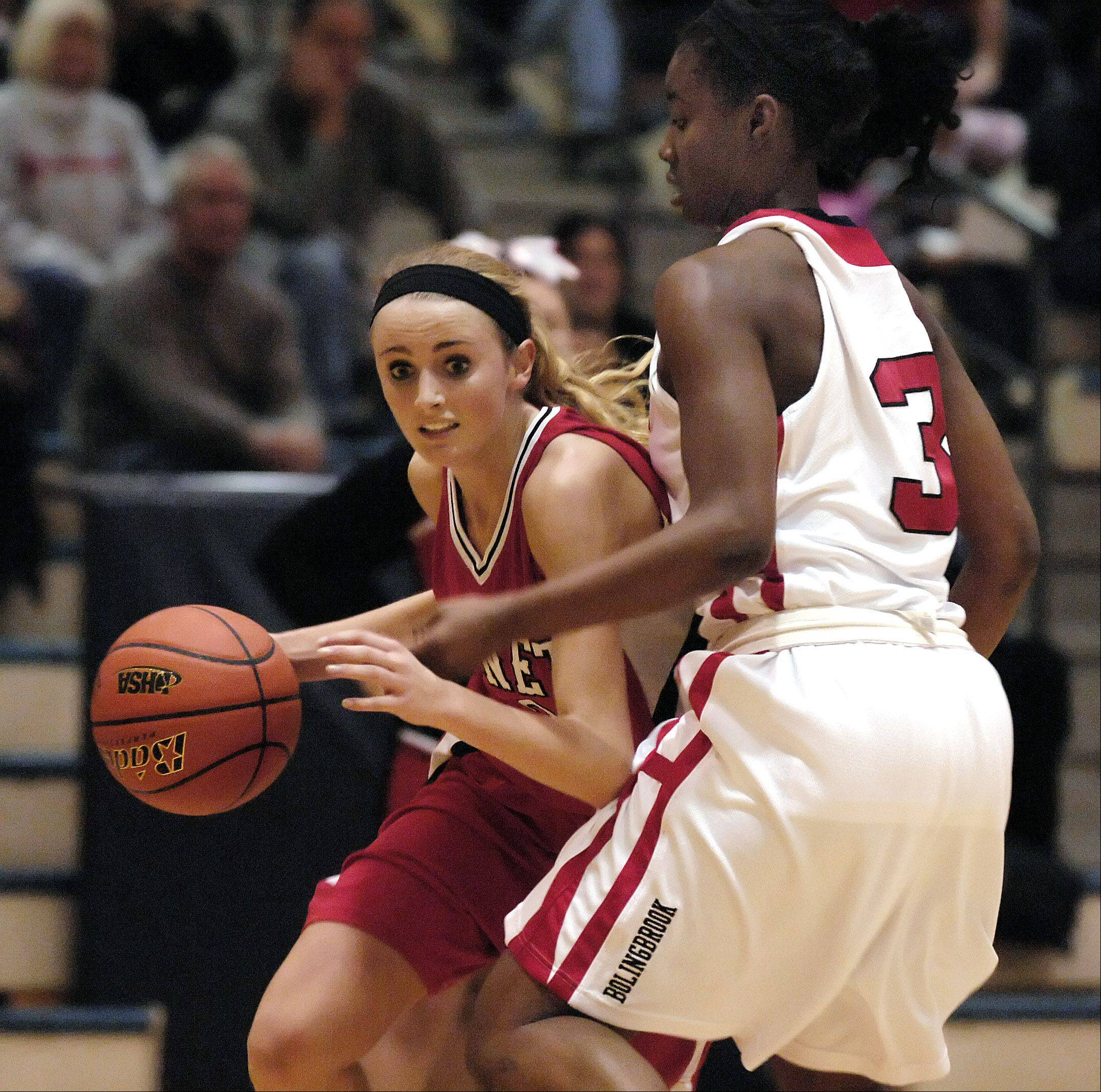 Benet Academy's Christine Prasse drives past Bolingbrook's Kennedy Cattenhead during Thursday's Class 4A girls basketball sectional final at Neuqua Valley high school in Naperville.