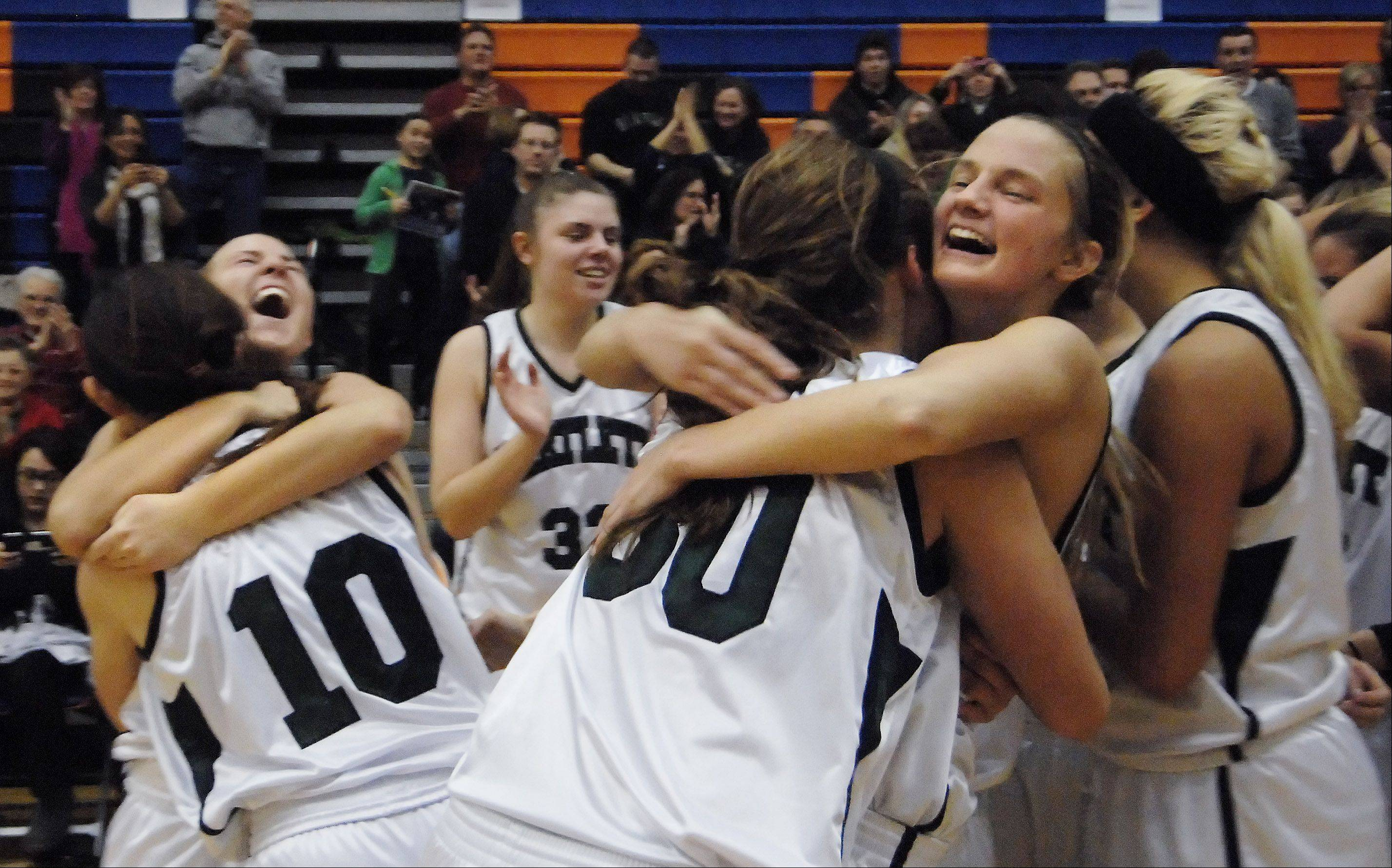 Bartlett's Alexandra Fleig, left, Nicole Gobbo, 10, Lisa Palmer and Kristin Conniff, right, hug after beating Wheaton Warrenville South in Thursday's Class 4A Hoffman Estates sectional final.