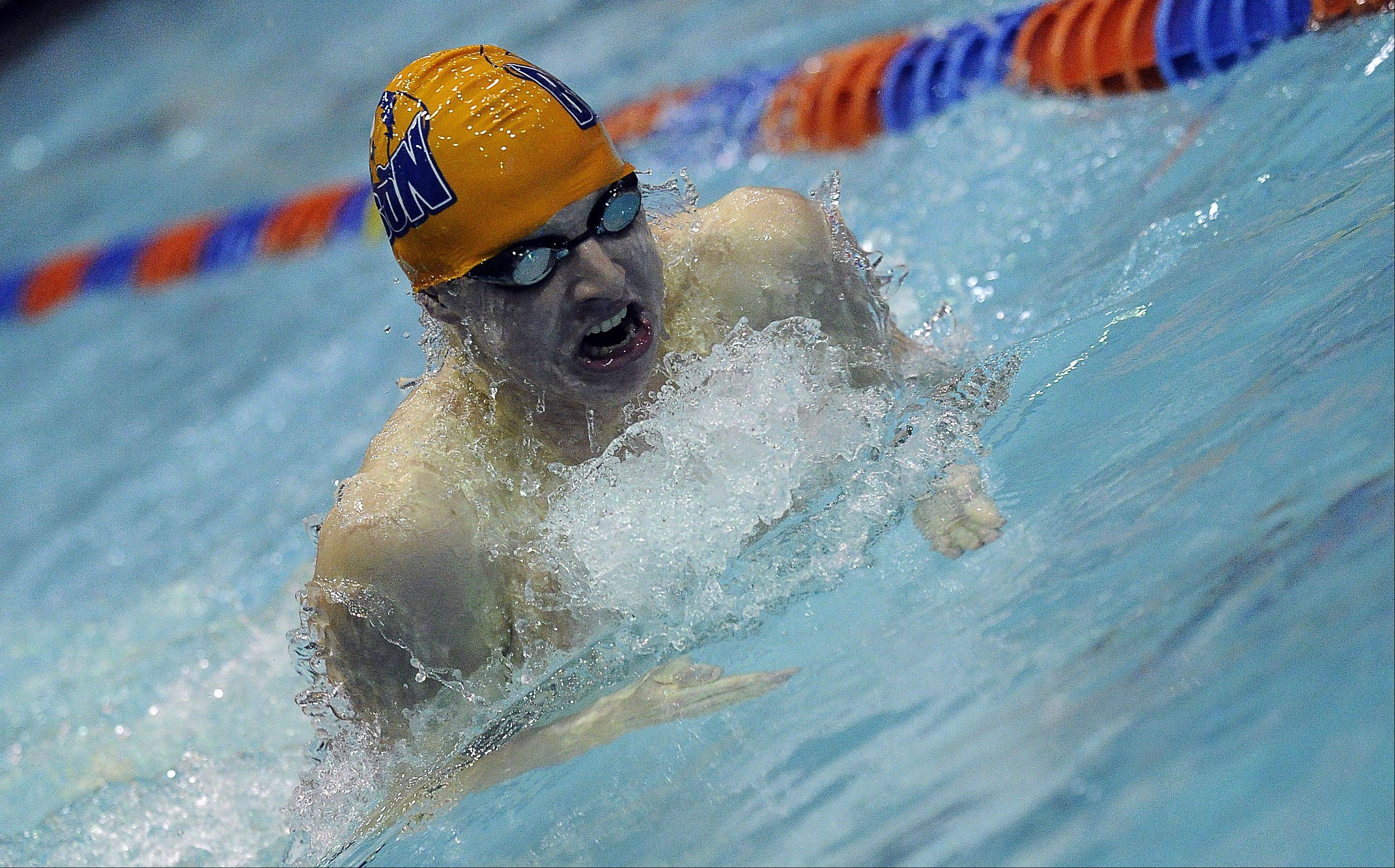 Buffalo Grove's Ian Rodriguez swims the 100-yard breaststroke during Friday's state swimming preliminaries at Evanston High School.
