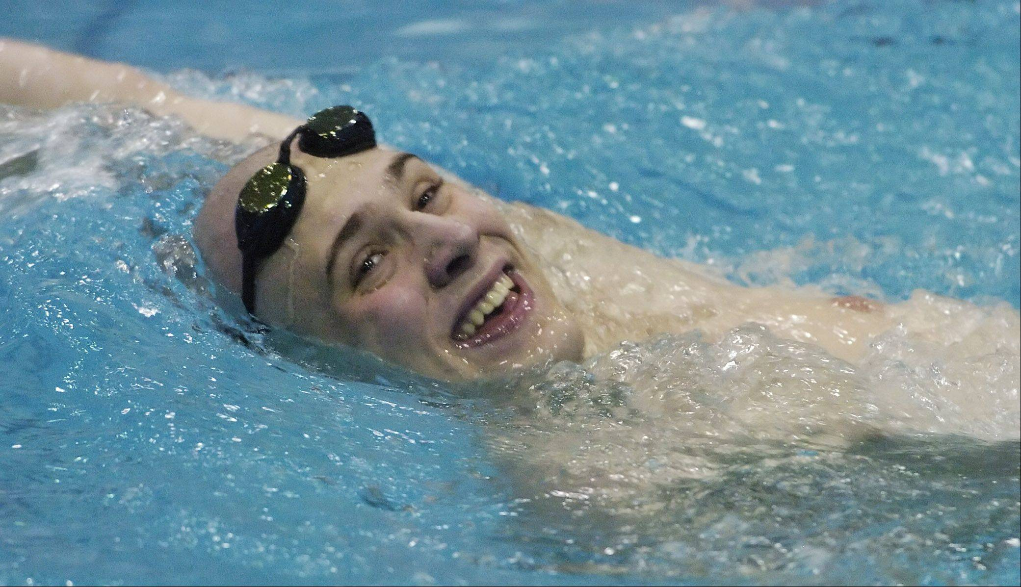 Danny Thomson of Hinsdale Central smiles at fans following the 500-yard freestyle during Saturday's boys state swimming finals at Evanston High School.