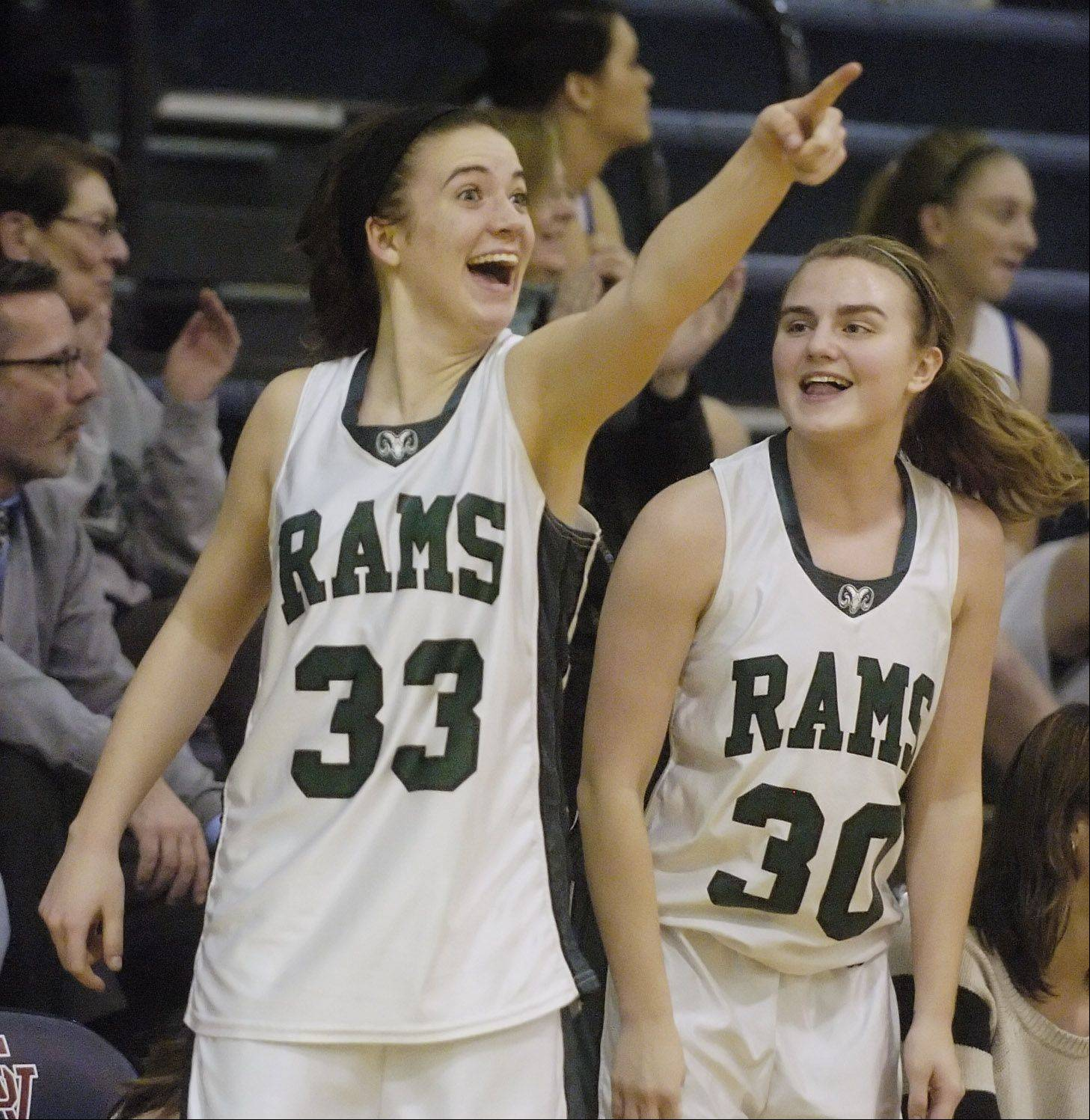 Grayslake Central's Skyler Jessop, left, and Michelle Lettenmair celebrate from the bench during Tuesday's Class 3A girls basketball sectional semifinal against Grayslake North at St. Viator High School in Arlington Heights.