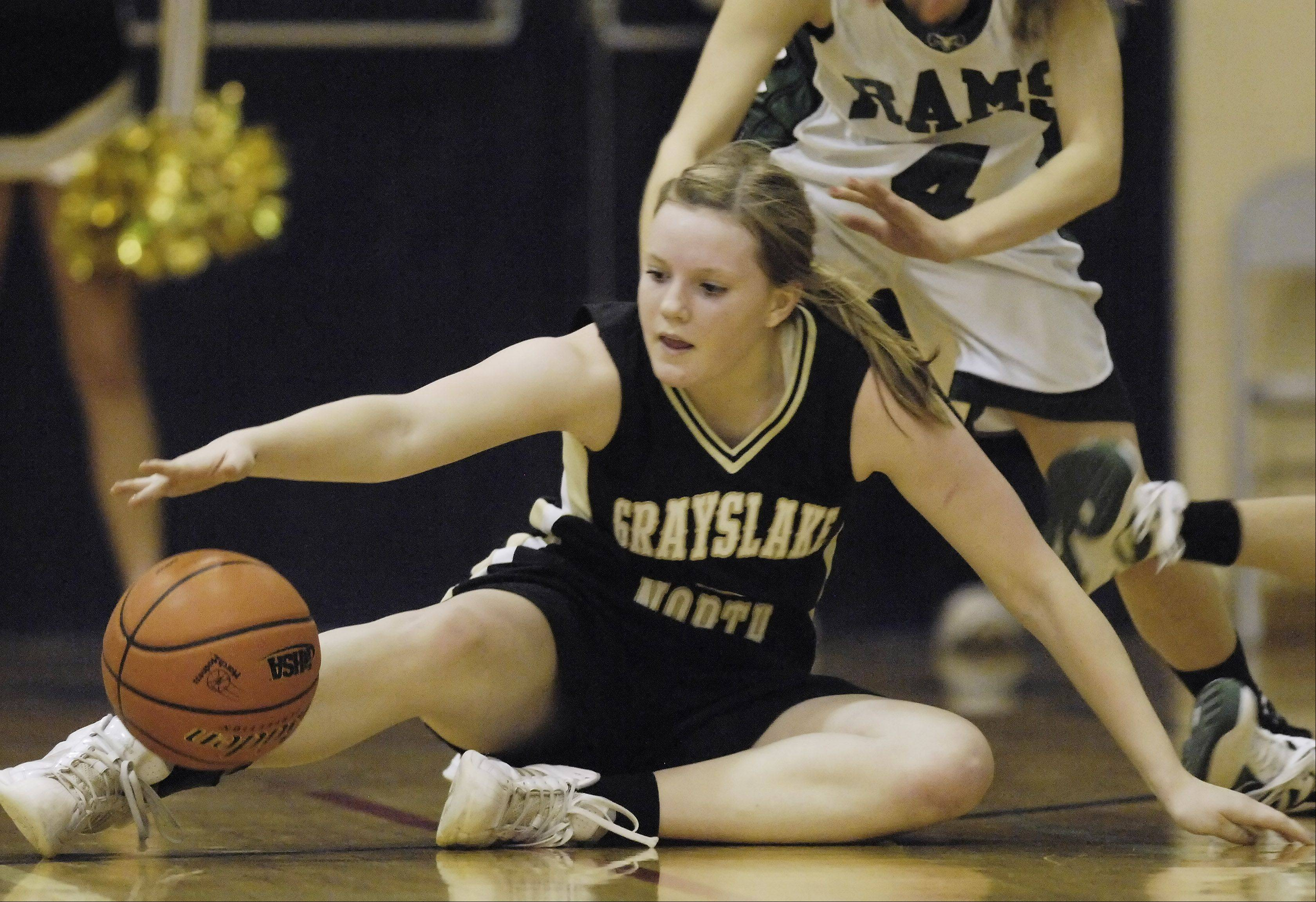 Grayslake North's Katie McGrath grabs for a loose ball during the Class 3A girls basketball sectional semifinal against Grayslake Central Tuesday in Arlington Heights.
