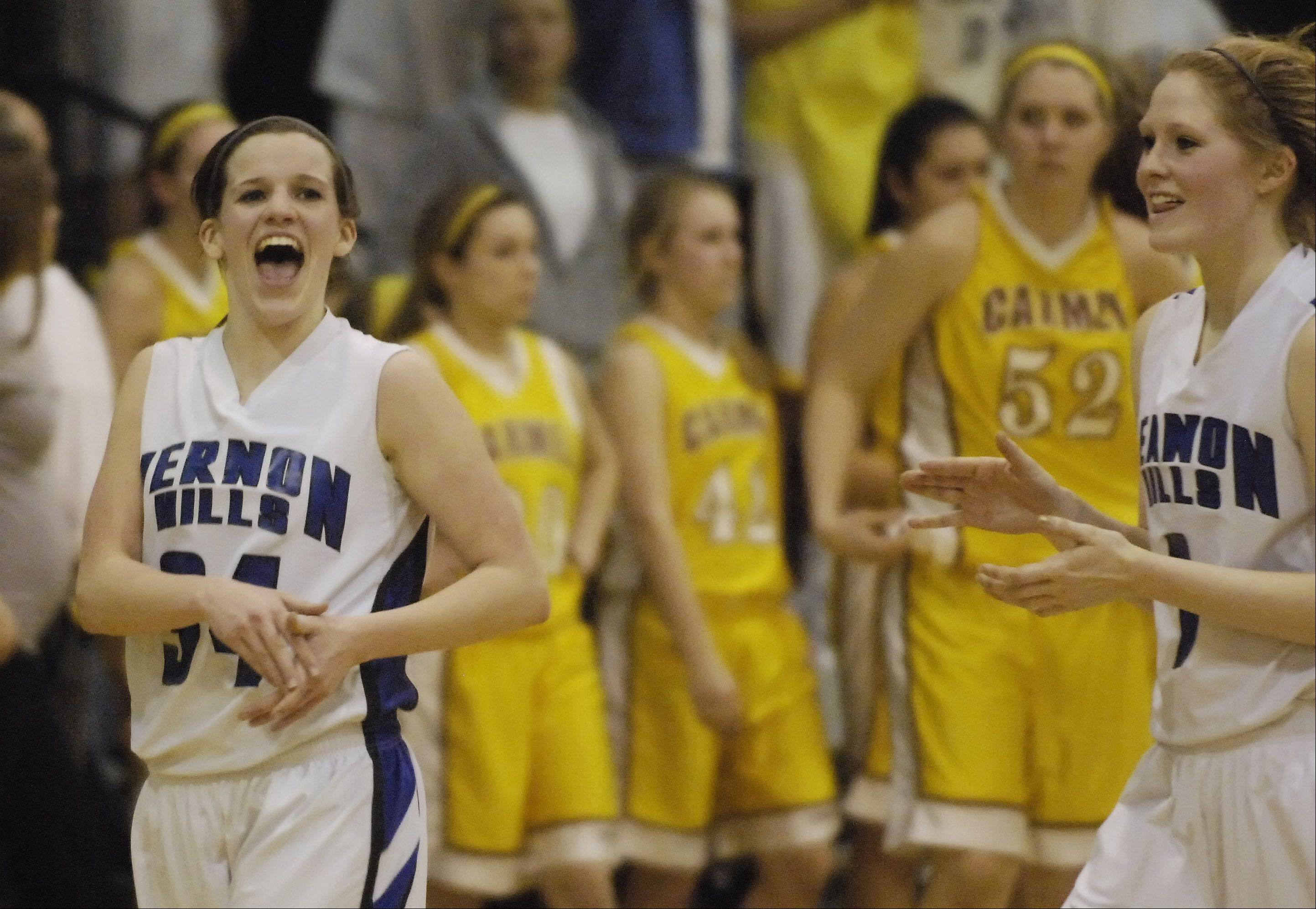 Vernon Hills' Abby Springer, left, and teammate Sydney Smith celebrate their team's victory over Carmel during the Class 3A girls basketball sectional semifinal game Tuesday at St. Viator High School in Arlington Heights.