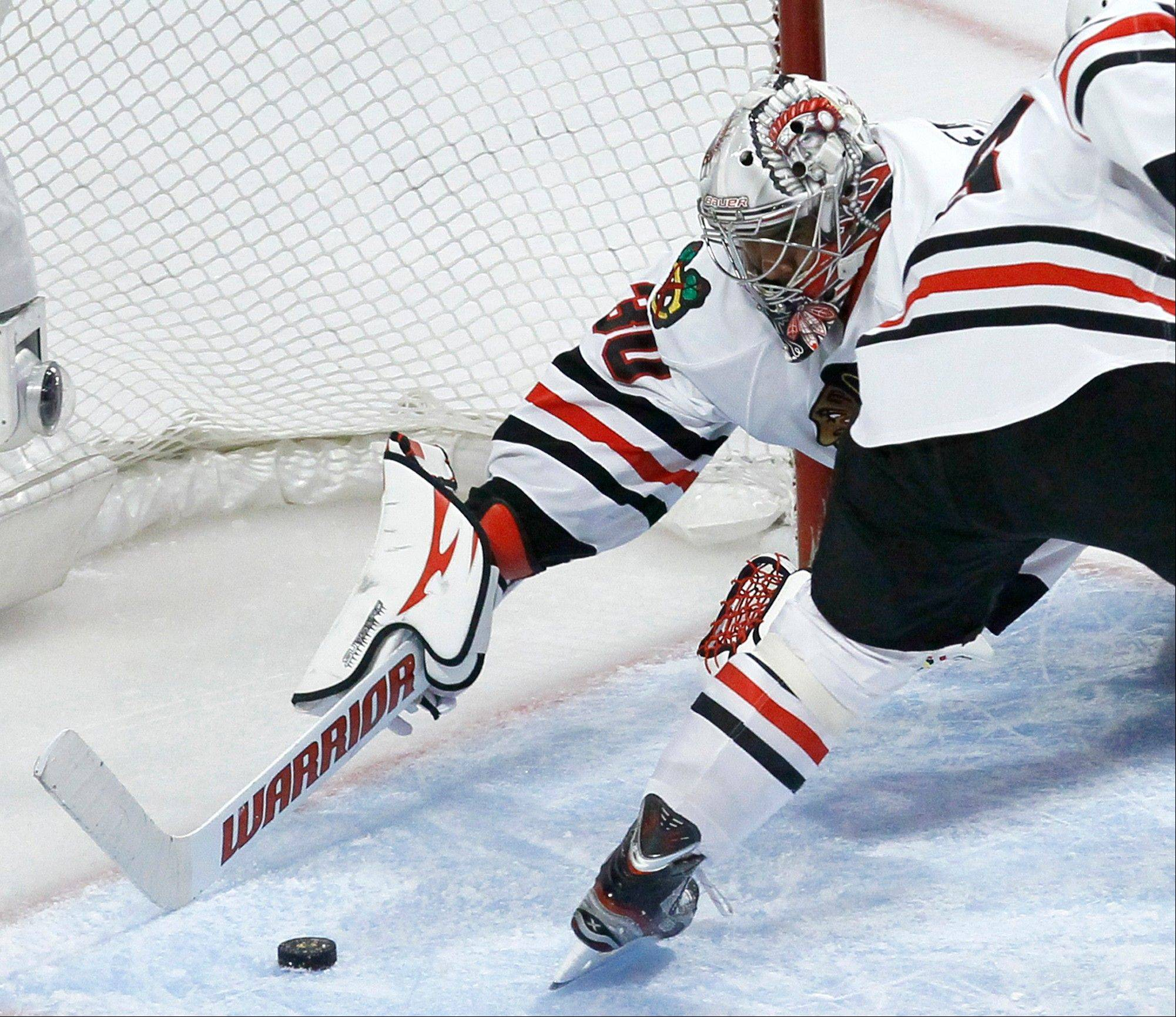 Hawks overcome shaky start, beat Leafs