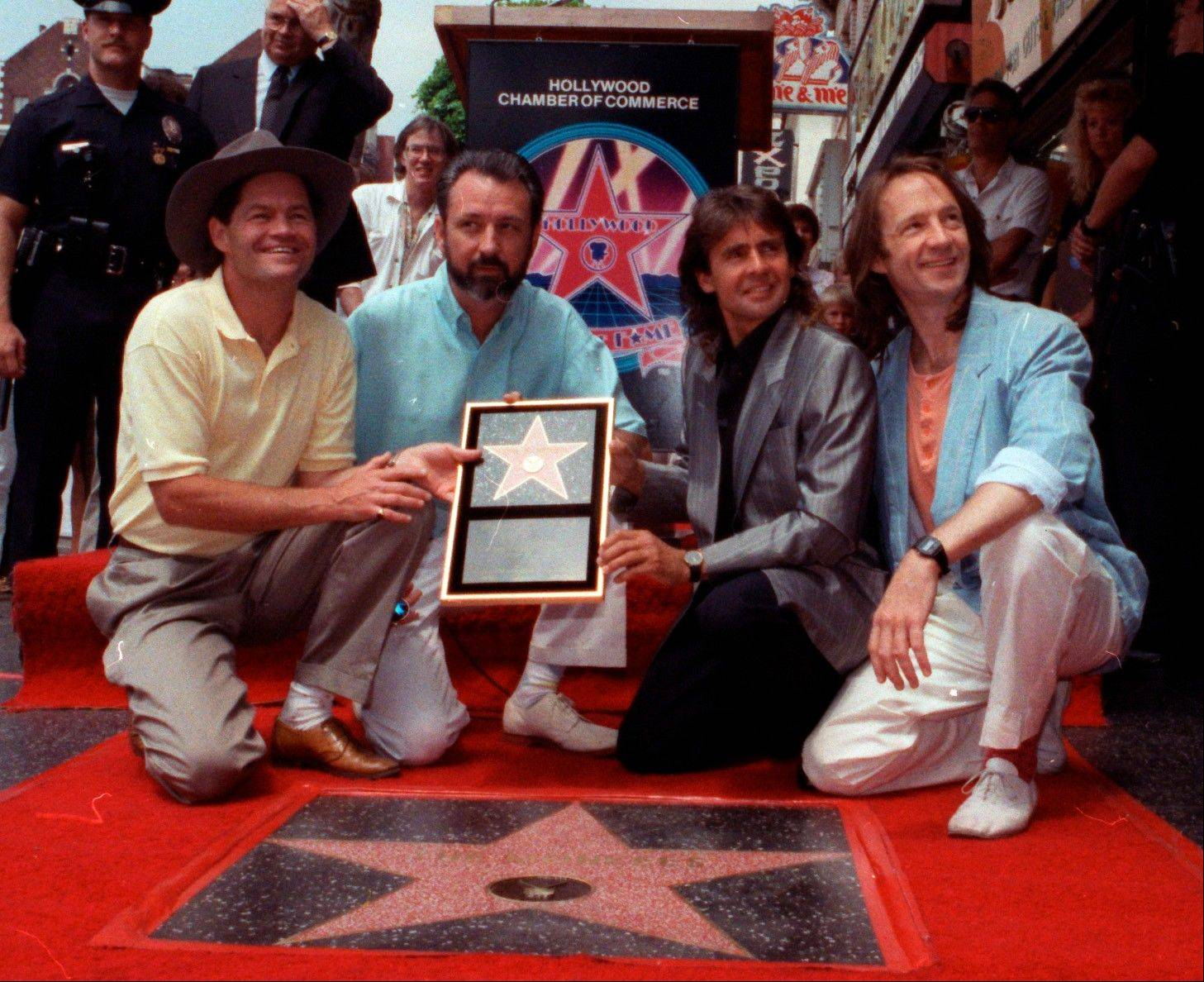 In this July 10, 1989 file photo, The Monkees, from left: Micky Dolenz, Mike Nesmith, Davy Jones and Peter Tork get a star on the Hollywood Walk of Fame in Los Angeles.