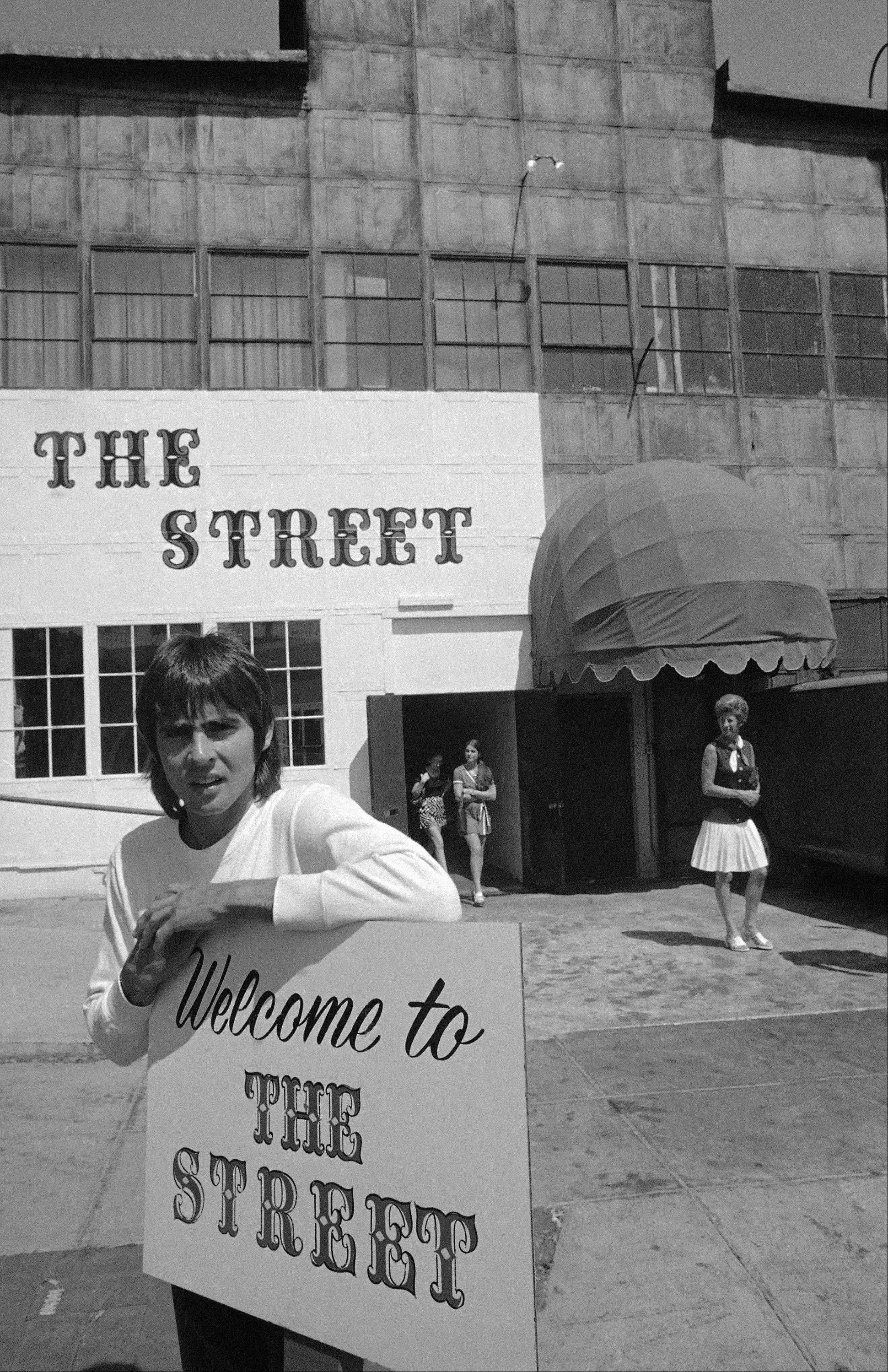 David Jones, 24, one of television's rock group, The Monkees, in a new Hollywood marketplace called The Street in Los Angeles on August 5, 1970, which he originated to help young craftsmen display and sell their products.