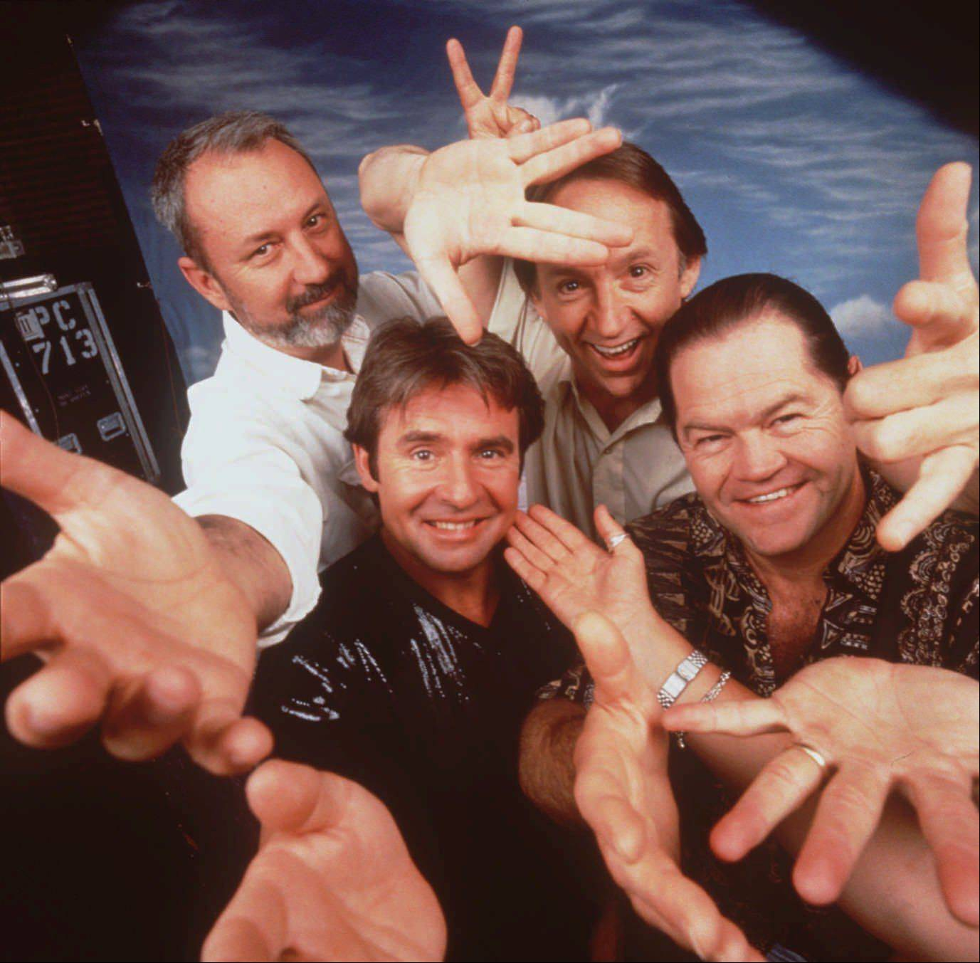 Rock band the Monkees pose for a group portrait in a Burbank, Calif., rehearsal studio in this 1996 photo. From left, are: Mike Nesmith, Davy Jones, Peter Tork and Mickey Dolenz.