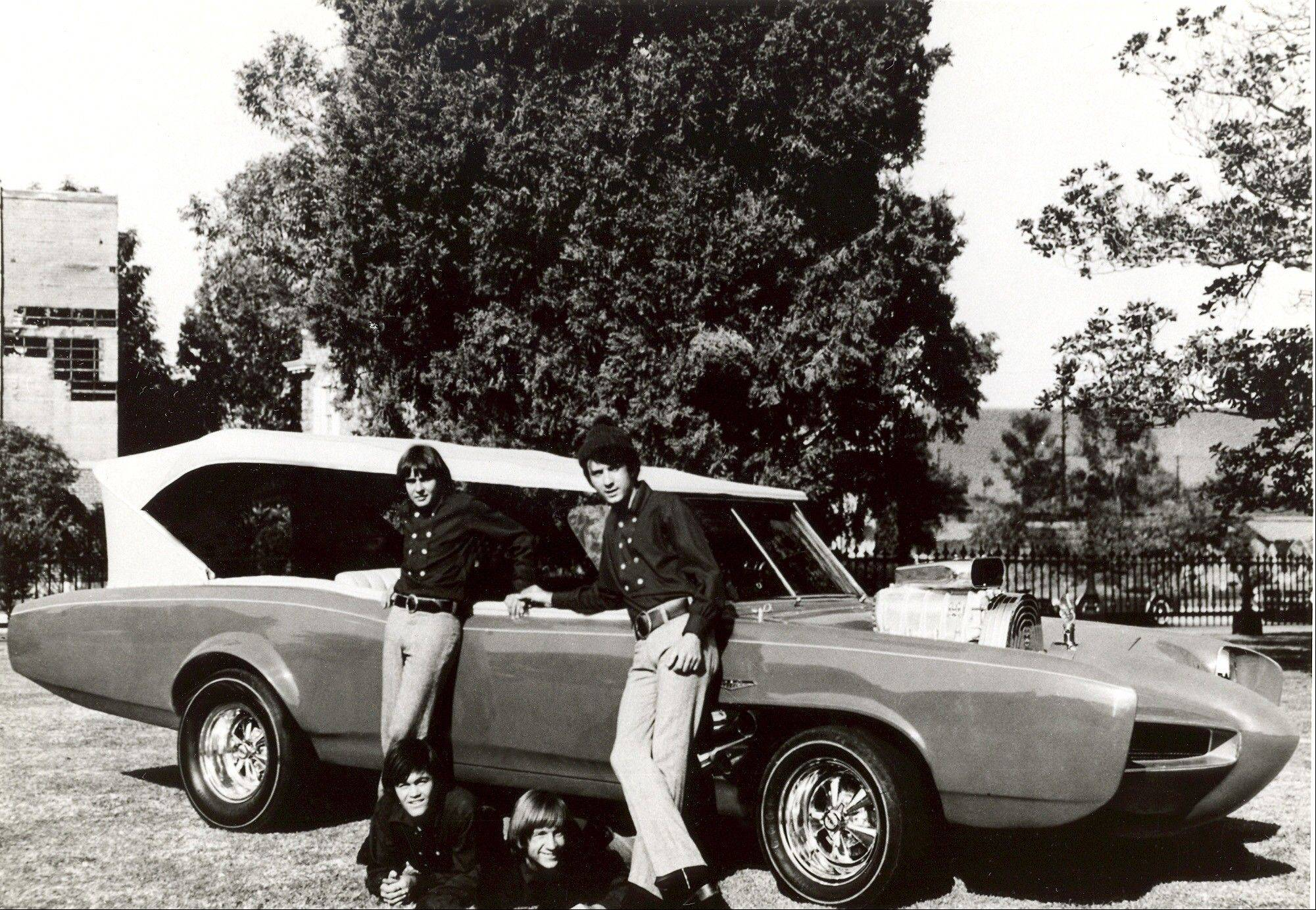 "In this 1966 file photo, cast members of the television show ""The Monkees,"" from top left, Davy Jones, Michael Nesmith, from lower left, Micky Dolenz, and Peter Tork pose next to their customized Pontiac GTO. Jones died Wednesday Feb. 29, 2012 in Florida. He was 66. Jones rose to fame in 1965 when he joined The Monkees, a British popular rock group formed for a television show. Jones sang lead vocals on songs like ""I Wanna Be Free"" and ""Daydream Believer."""