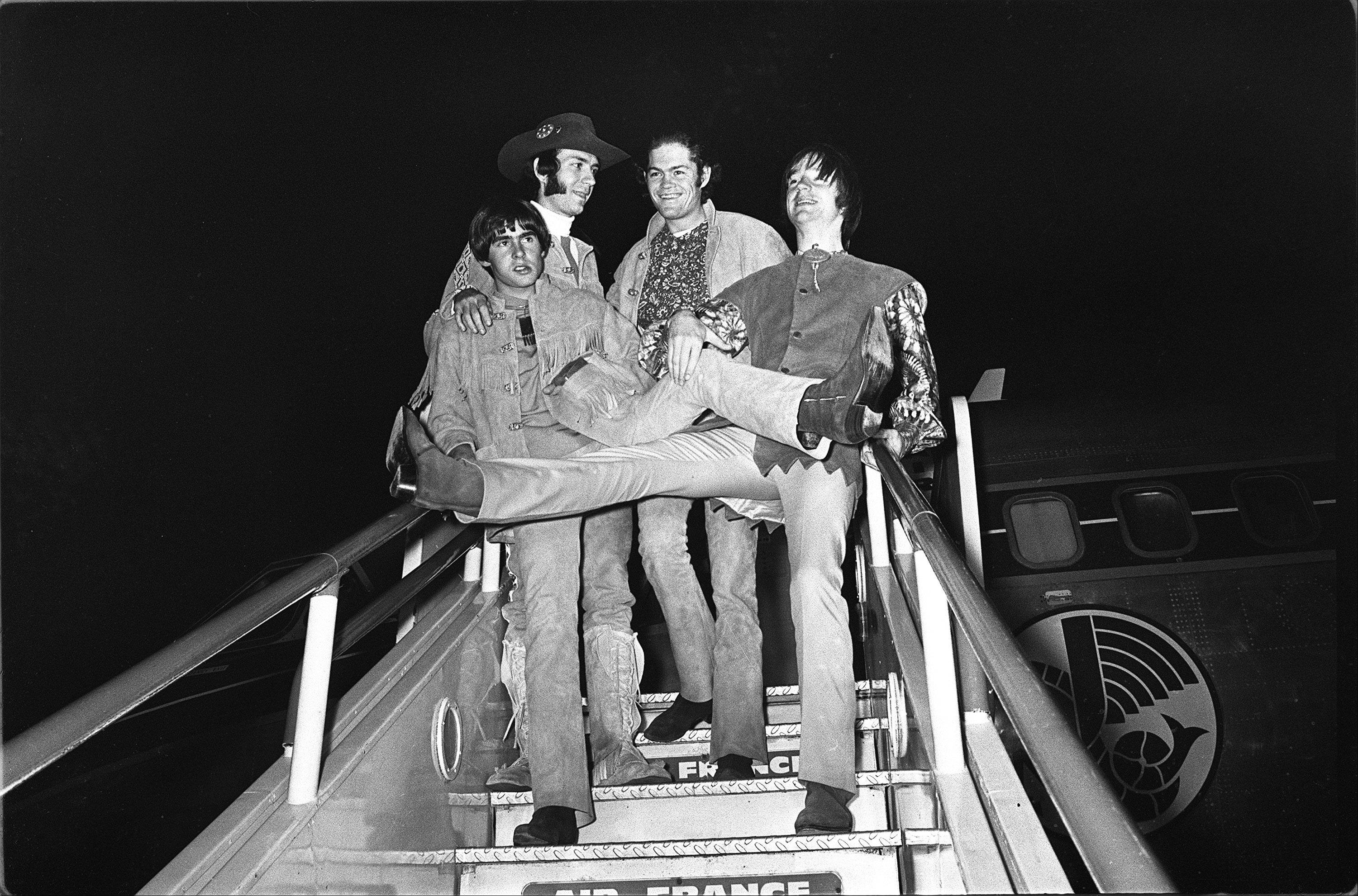 American pop group, the Monkees, pictured on arrival at London Airport, 28th June, 1967. Arriving from Paris, the group will perform a live stage show at the Empire Pool, Wembley, this coming weekend. Left to right are Davy Jones, Peter Tork, Micky Dolenz and Mike Nesmith.