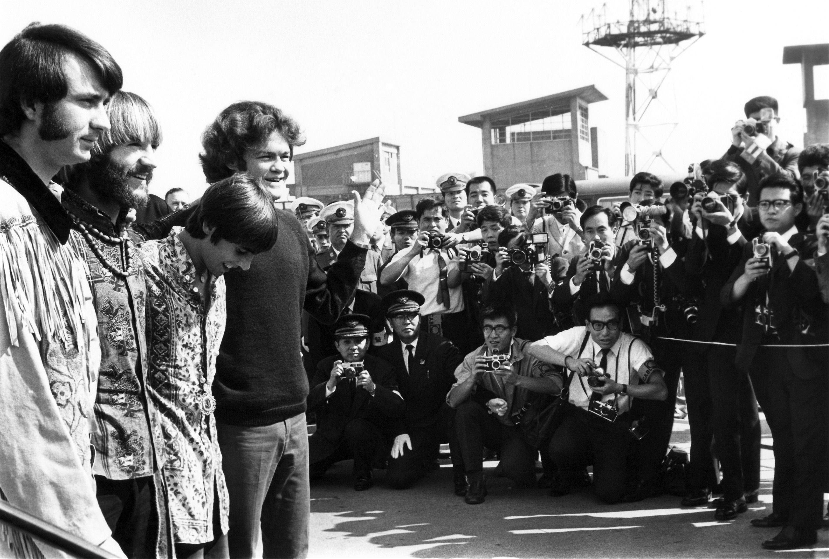 The pop musical group, The Monkees, arrived at Tokyo International Airport Sept. 30, 1968 for the performances in Tokyo, Kyoto and Osaka. About 1,000 Japanese fans, mostly teen aged girls gathered at the airport to see The Monkees. From right Micky Dolenz, Davy Jones, Peter Tork, Mike Nesmith. About 700 Japanese police surrounded the airport to protect Monkees from crowd but no mob scene.