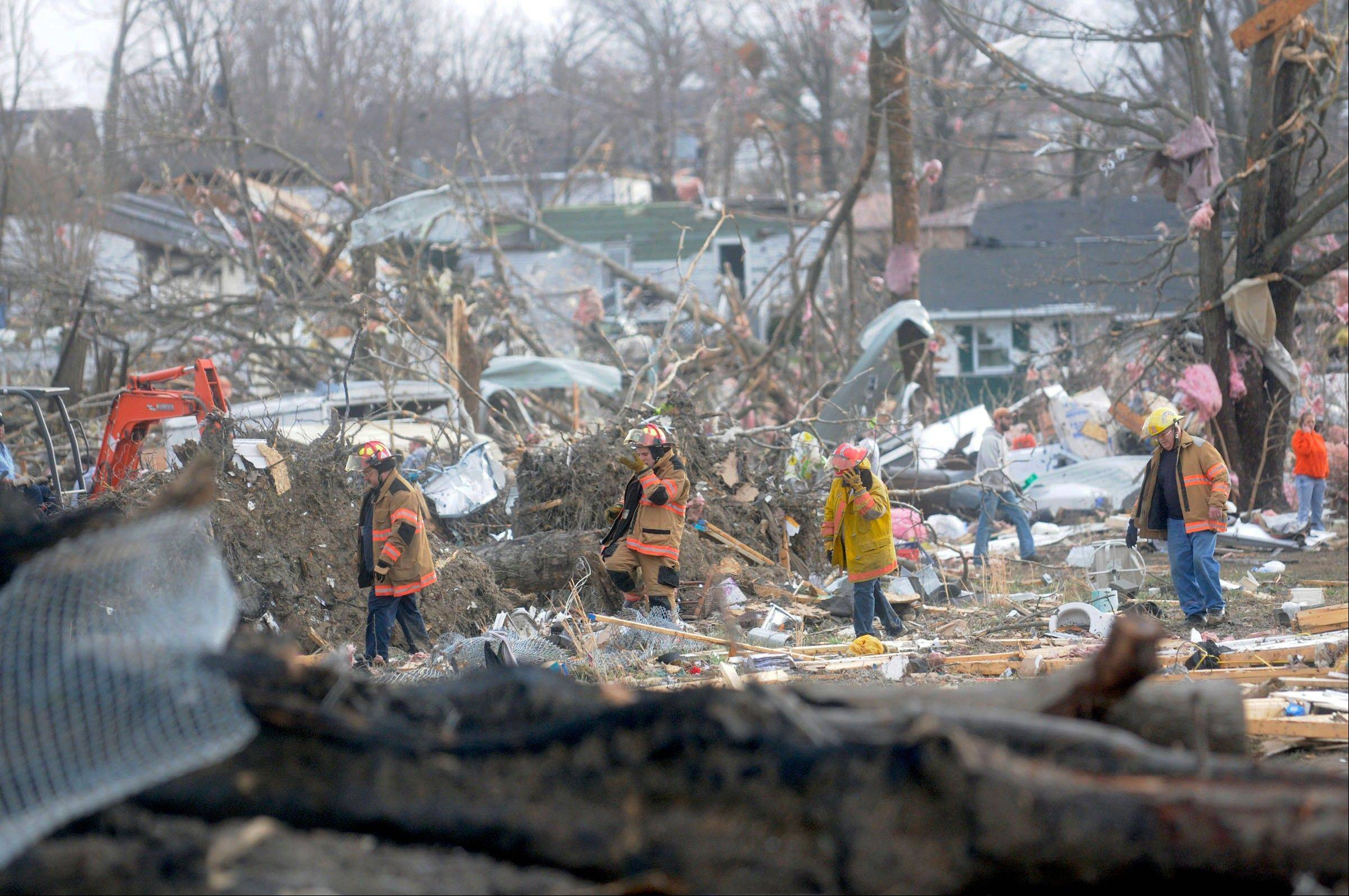 Emergency crews comb through some of the damage after a severe storm hit in the early morning hours on Wednesday, Feb. 29, 2012, in Harrisrbug, Ill. A severe pre-dawn storm pounded portions of southern Illinois on Wednesday. Several deaths have been reported in Harrisburg and left the city's medical center scrambling to treat an influx of injured, the hospital's top administrator said.