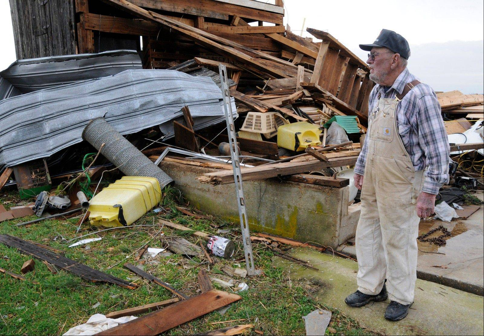 D.L. Douglas, 80, surveys the damage to a barn near his house northeast of Puxico, Mo., after a storm ripped through the area around 4 a.m. Wednesday, Feb. 29, 2012. Douglas and his wife survived without injuries, but a resident of a nearby mobile home died from injuries he suffered when the trailer was lifted and moved about 80 yards from its original location.