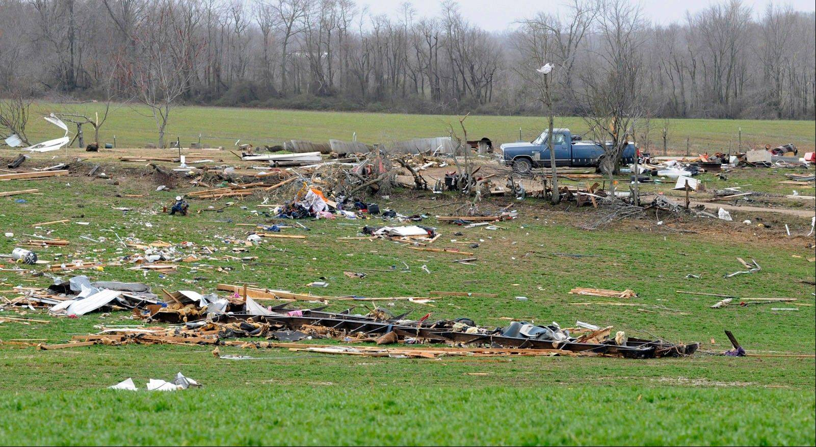 A mobile home occupied by two Puxico, Mo., residents sits destroyed in a field about 80 yards from its original location after an early morning storm passed through the area Wednesday, Feb. 29, 2012. Both residents were airlifted to a Cape Girardeau, Mo., hospital.