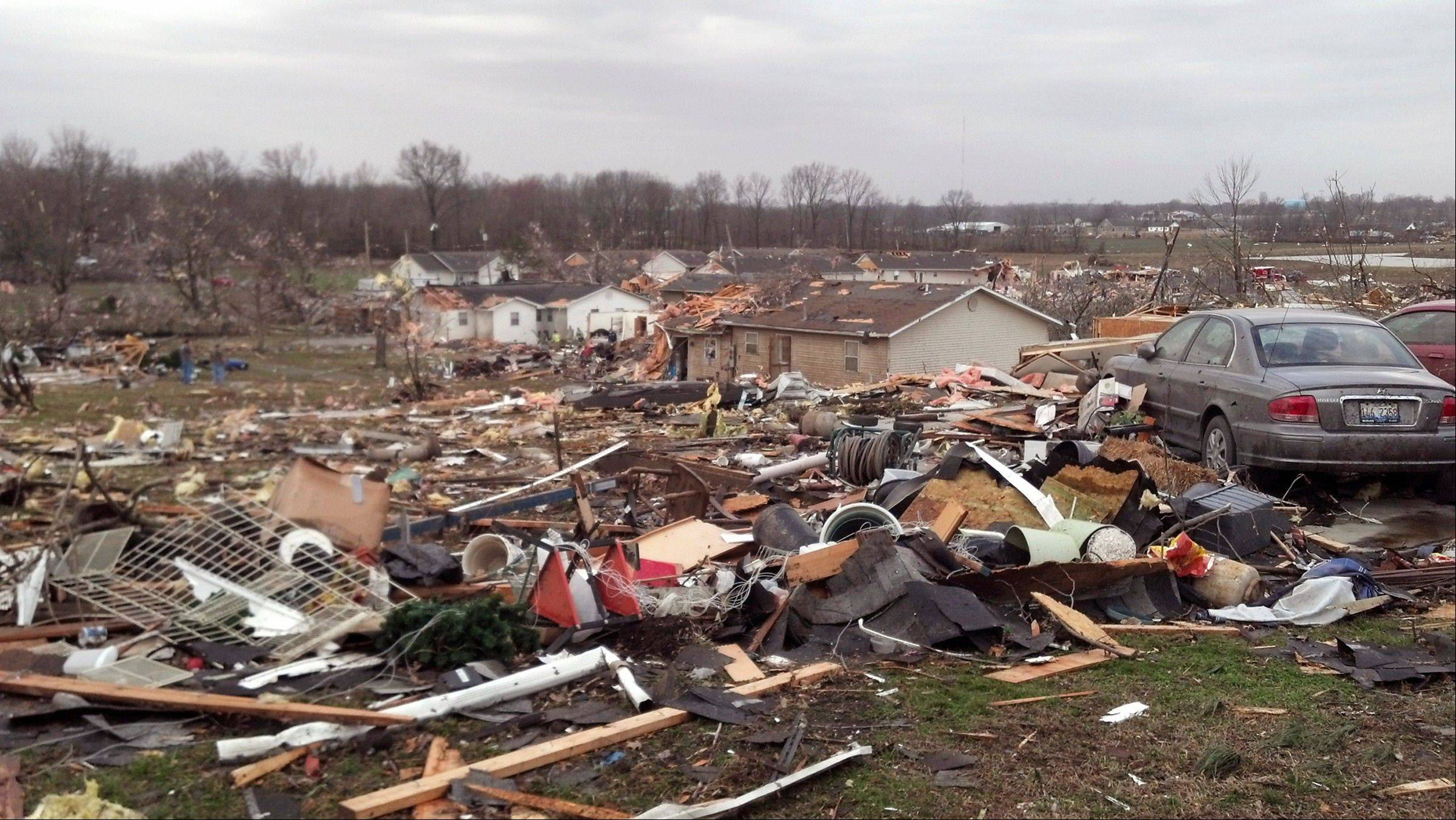 In this image made with a cellphone, a residential area is heavily damaged in Harrisburg, Ill., after a severe storm swept through the area early Wednesday morning, Feb. 29, 2012. A hospital administrator in Harrisburg says at least three people were killed in the storm that swept through the region.