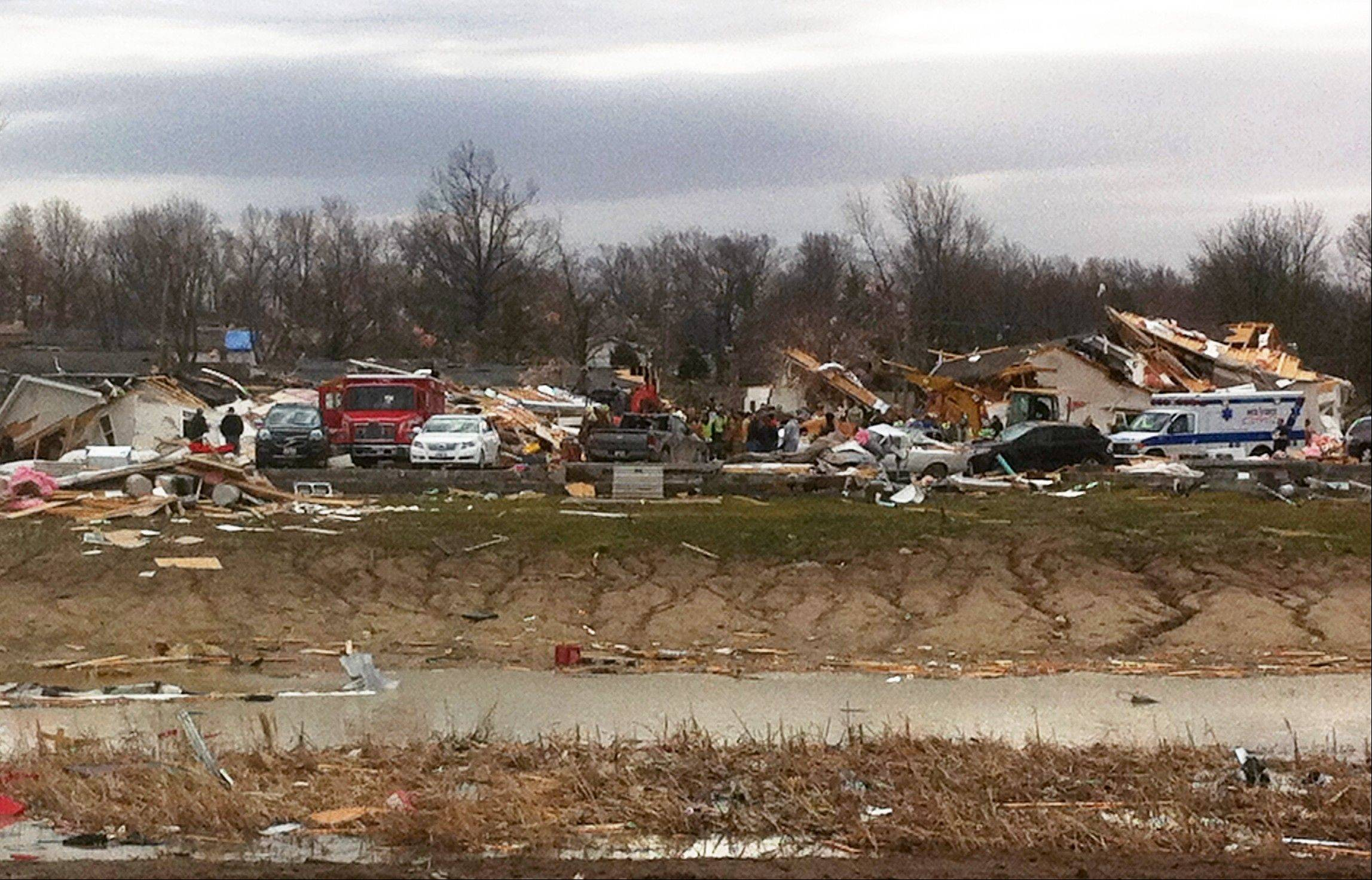 A residential area in Harrisburg, Ill. is damaged after a storm passed, Wednesday, Feb. 29, 2012. A severe pre-dawn storm pounded portions of southern Illinois on Wednesday. Several deaths have been reported in Harrisburg and left the city's medical center scrambling to treat an influx of injured, the hospital's top administrator said.