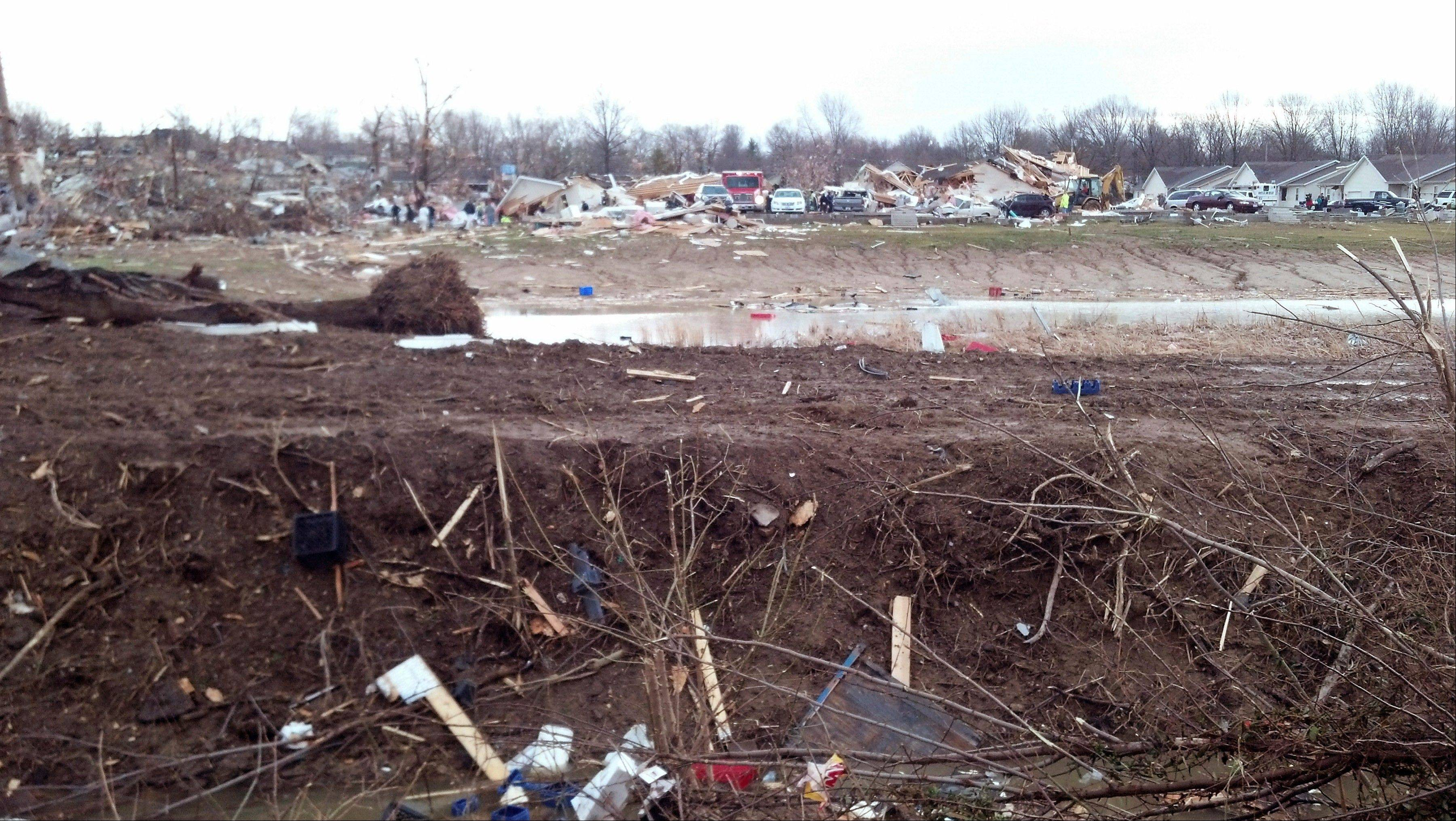 In this image made with a cellphone, a residential area is seen severely damaged in Harrisburg, Ill., after a severe storm swept through the area early Wednesday morning, Feb. 29, 2012. At least three people are confirmed dead in Harrisburg, said Harrisburg Medical Center CEO Vince Ashley, and the city's medical center scrambling to treat an influx of injured.
