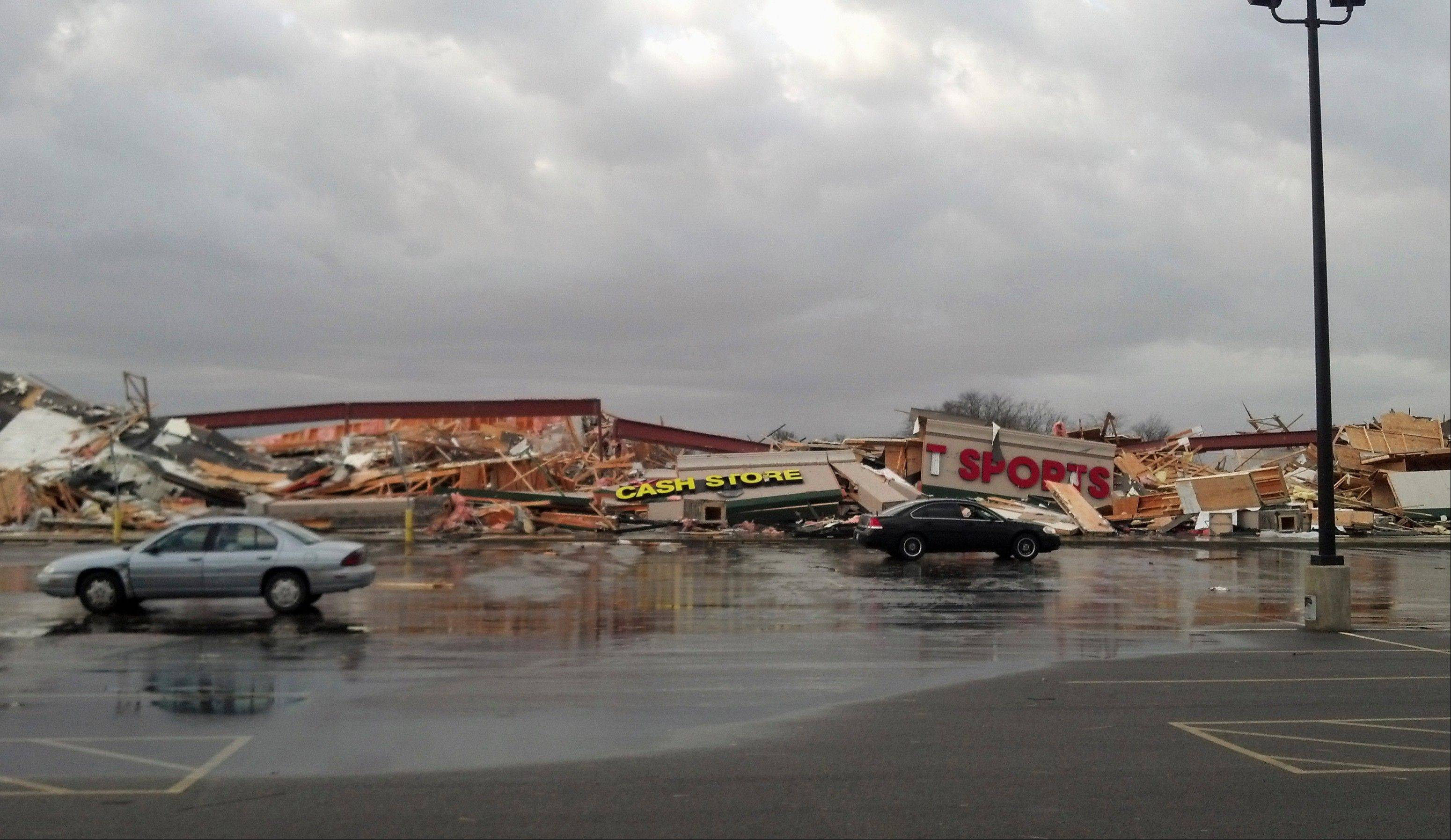 In this image made with a cellphone, damage is seen to a strip mall in Harrisburg, Ill., after a severe storm swept through the area early Wednesday morning, Feb. 29, 2012. A hospital administrator in Harrisburg says at least three people were killed in the storm that swept through the region.