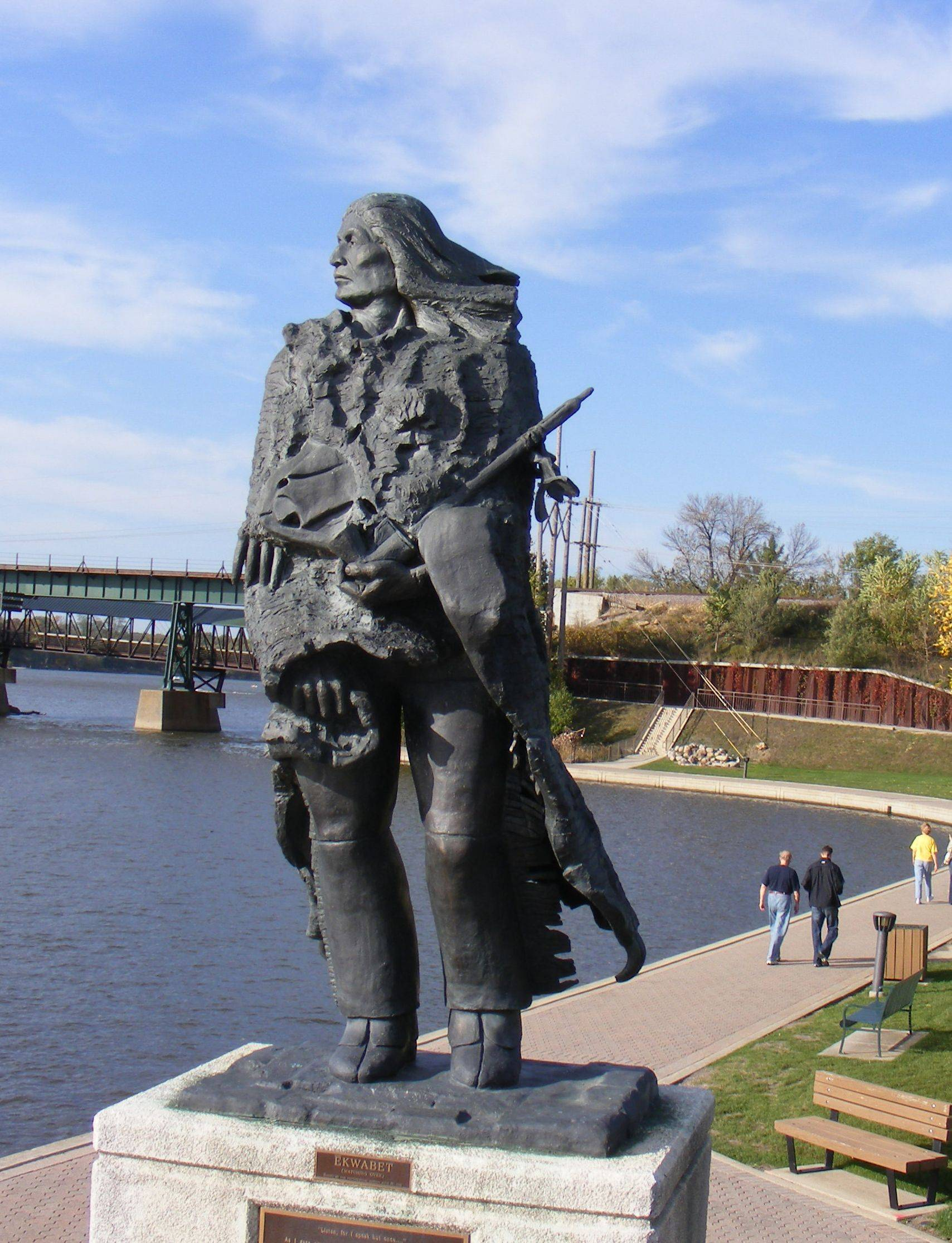 """Ekwabet"" by sculptor Guy Bellaver overlooks the Fox River. Bellaver's work will be on display Friday, March 2, when the Greater St. Charles Education Foundation hosts ArtFusion 2012 at St. Charles North High School."