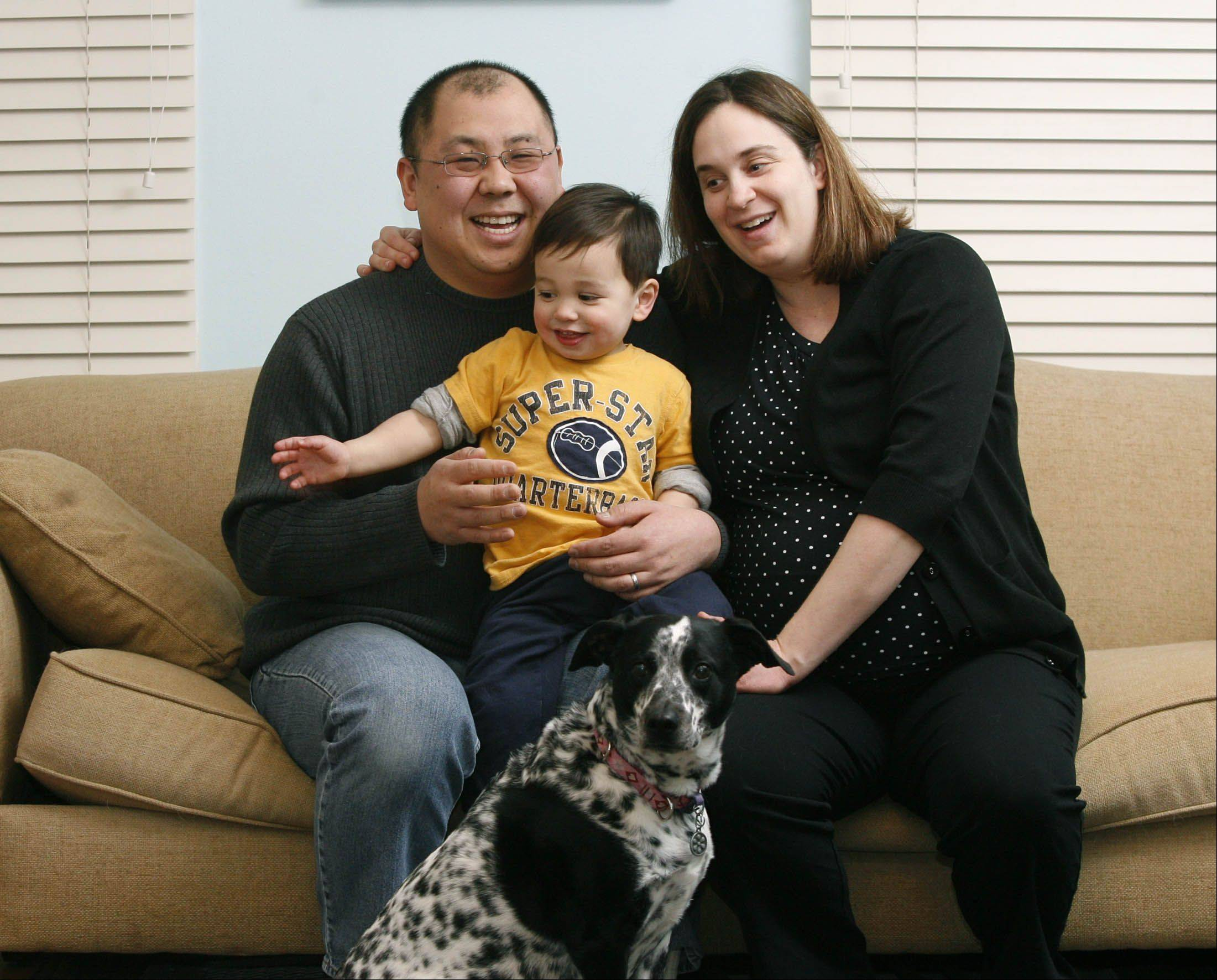 Daniel White/dwhite@dailyherald.com Edward and Lynne Shim of Roselle decided to have their baby induced on leap day. Their newborn daughter will be shared with their son Will, and dog Edie.