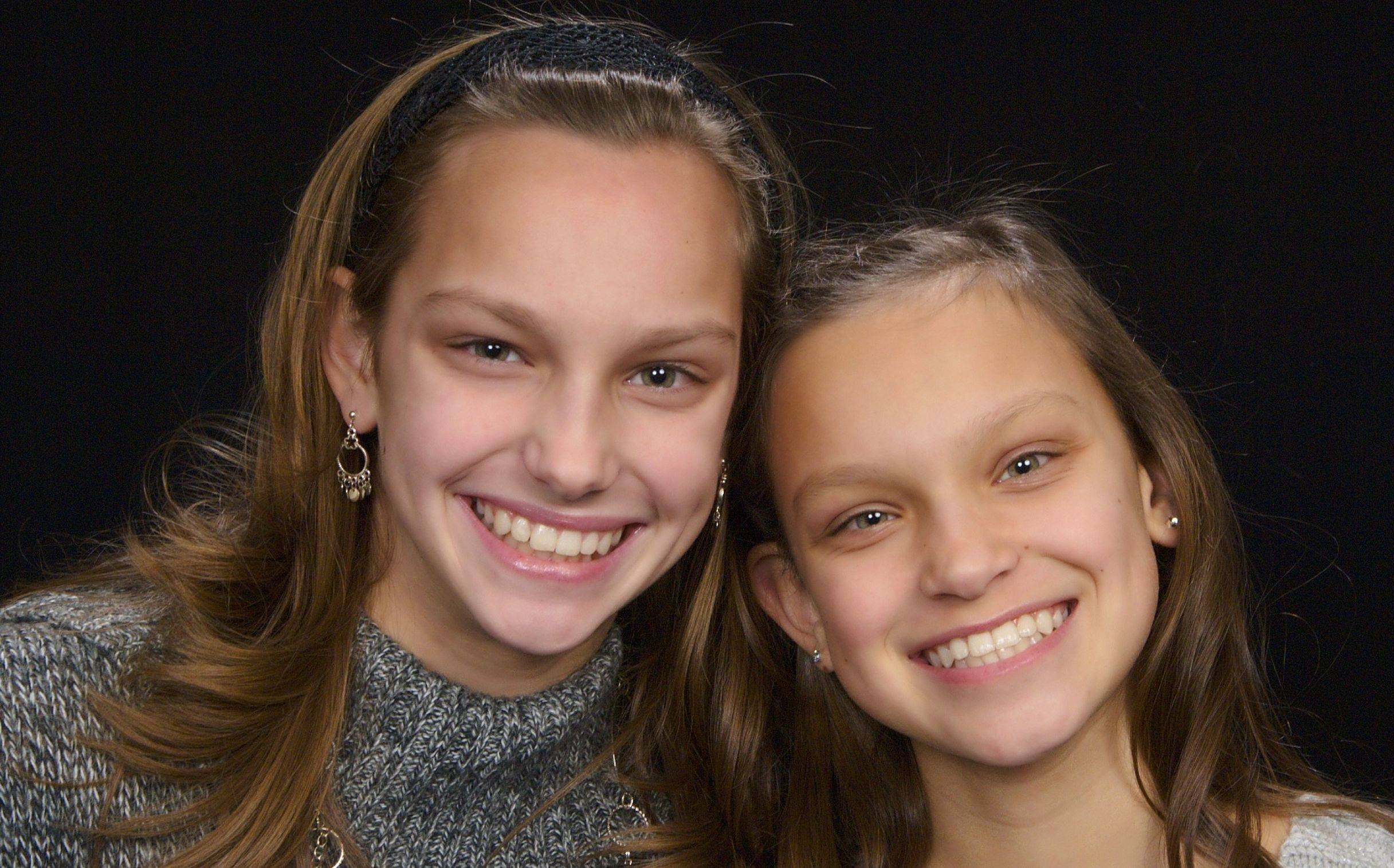 "Twin sisters Courtney, left, and Kaitlyn Goetz of Manhattan, Ill. at age 12. Their mother, Michelle, didn't have much of a choice for what day the pair would be born because of pregnancy complications. She said the girls like their Leap Day birthday. ""I wouldn't change it,"" she said."