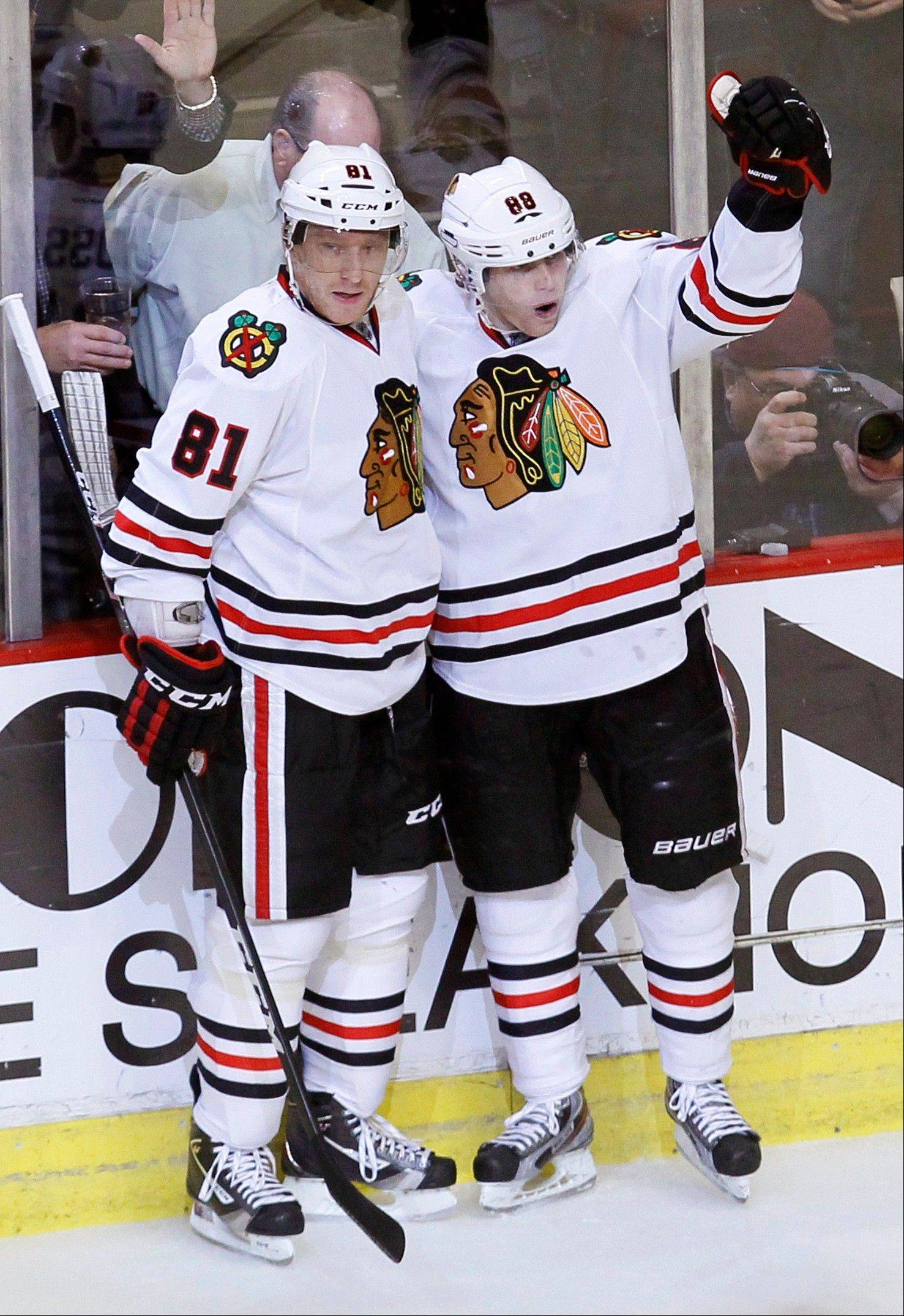 Blackhawks right wing Patrick Kane, right, celebrates his goal with Marian Hossa Wednesday during the second period.