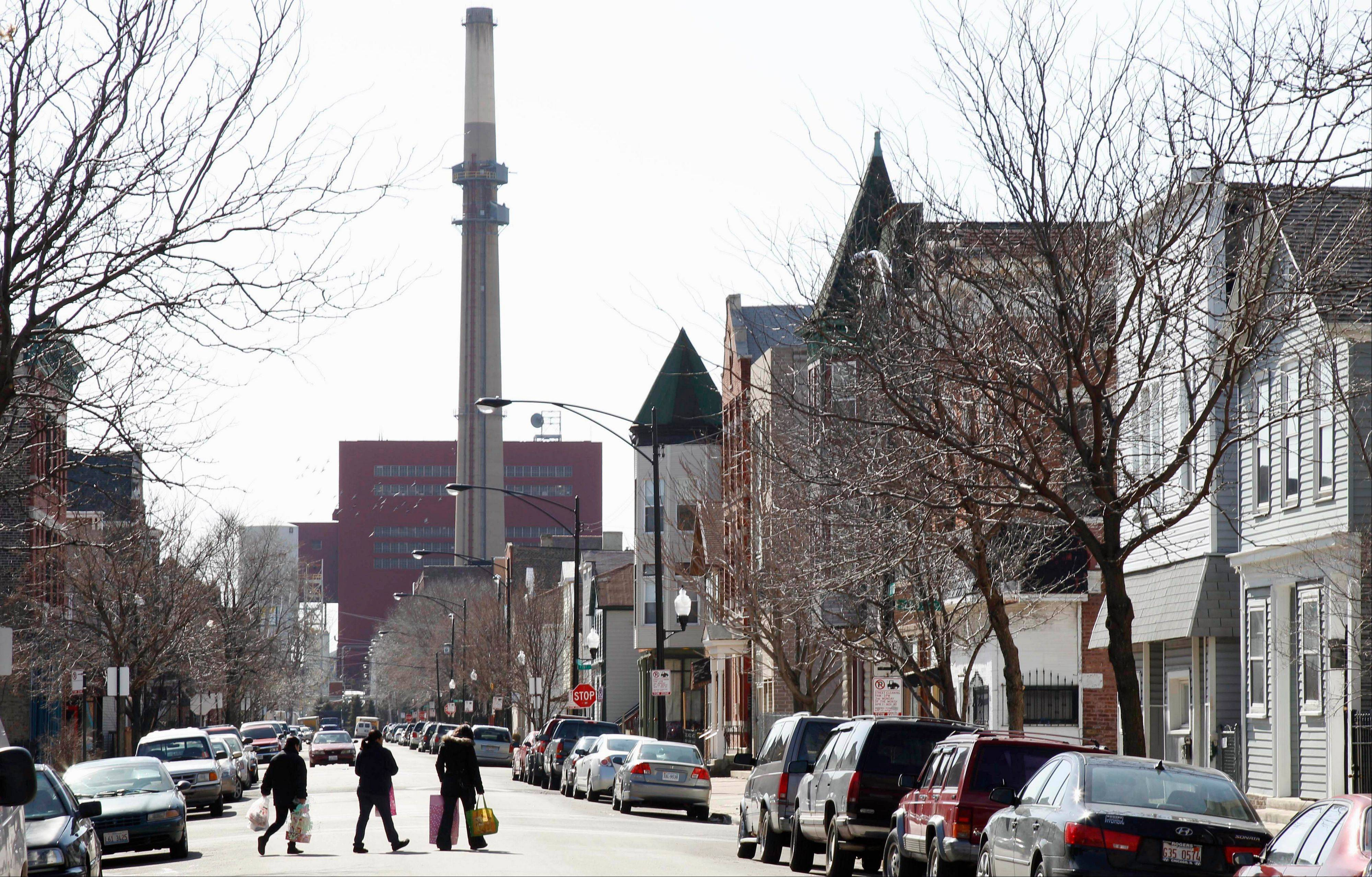 Midwest Generation's Fisk Generating Station, a coal-fired power plant, is seen in the background in Chicago's Pilsen neighborhood.  Associated Press