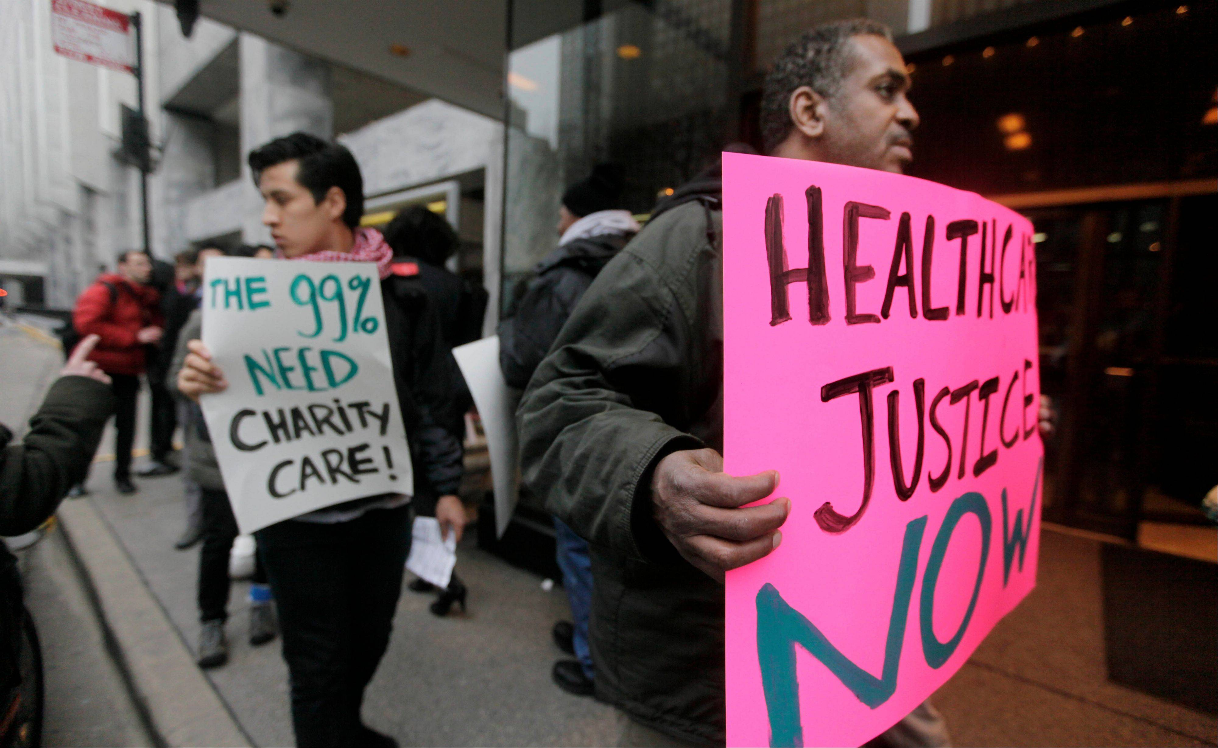Members of the Fair Care Coalition, representing patients, taxpayers, community leaders and health policy researchers, picket outside the Ritz-Carlton hotel Thursday in Chicago, where nonprofit hospital trustees were meeting to discuss hospital tax exemptions.
