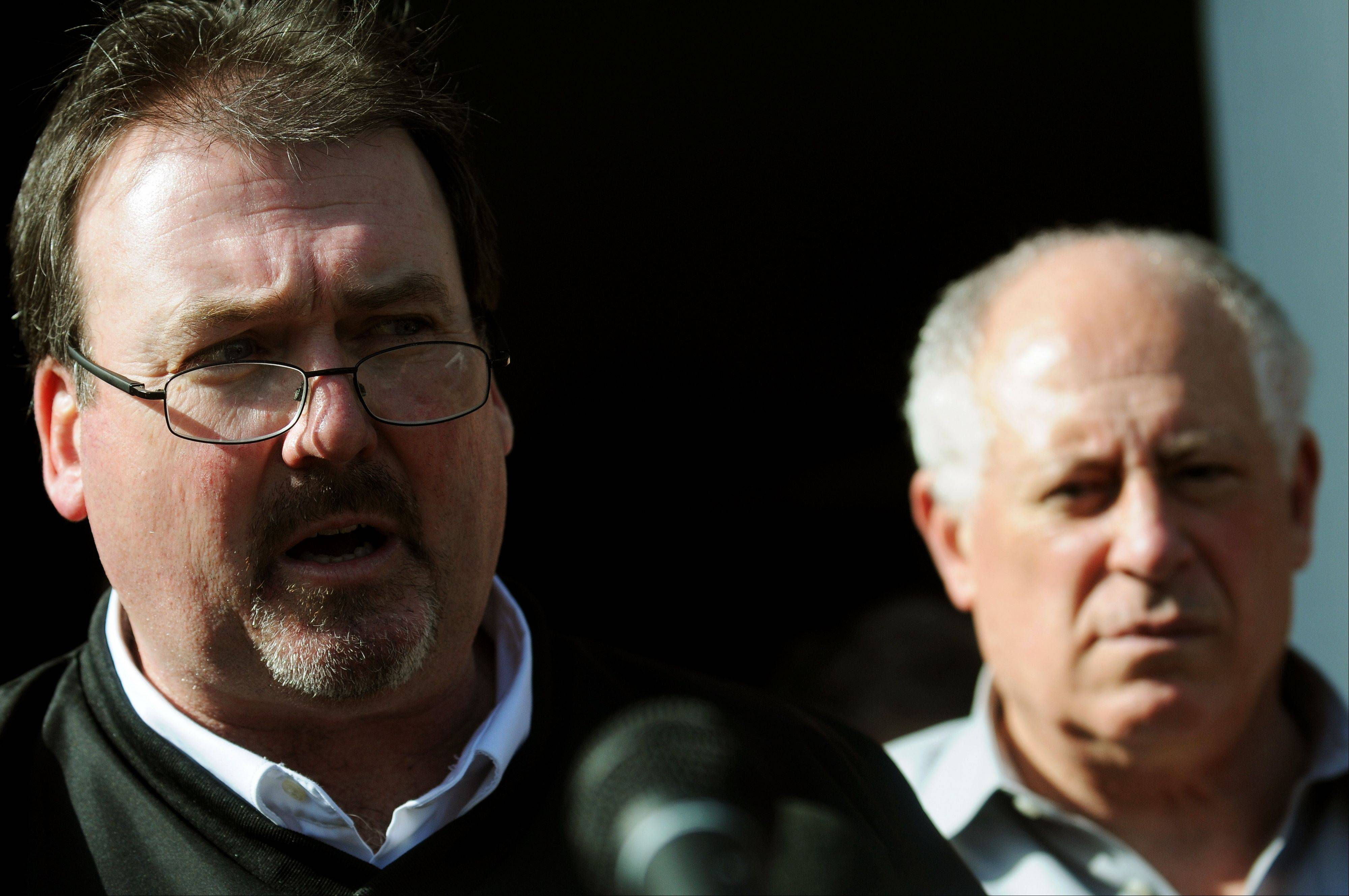 Harrisburg Mayor Eric Gregg talks about the destruction from a tornado as Illinois Gov. Pat Quinn listens during a news conference in Harrisburg, Ill., Wednesday, Feb. 29, 2012.