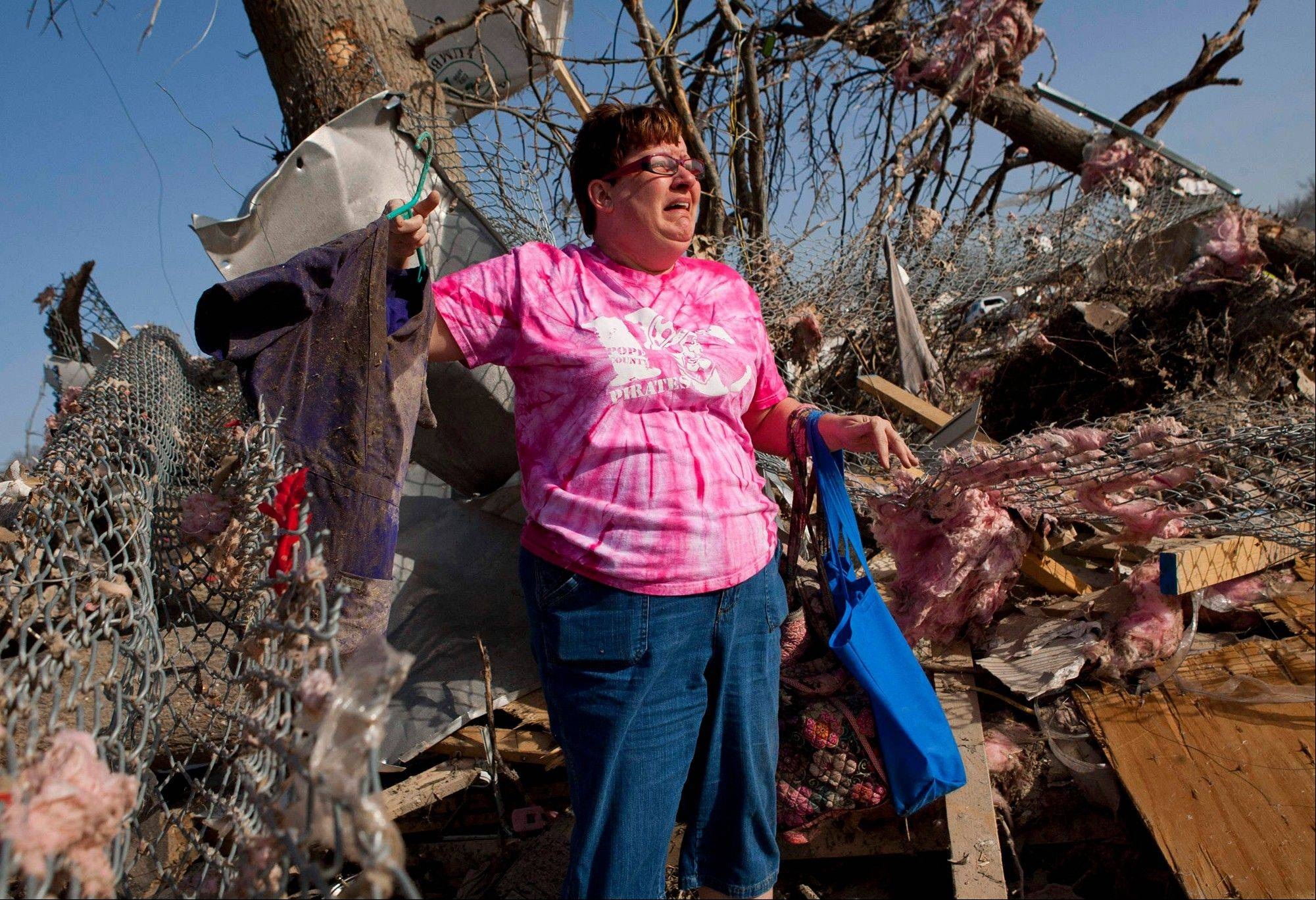 Patty Ferrell, of Herod, Ill., is overcome with emotion after finding the nursing scrubs that belonged to her daughter, Jaylynn Ferrell, 22, who was killed in a tornado that struck Harrisburg, Ill., on Wednesday, Feb. 29, 2012. The tornado destroyed the duplex where Jaylynn Ferrell had lived.