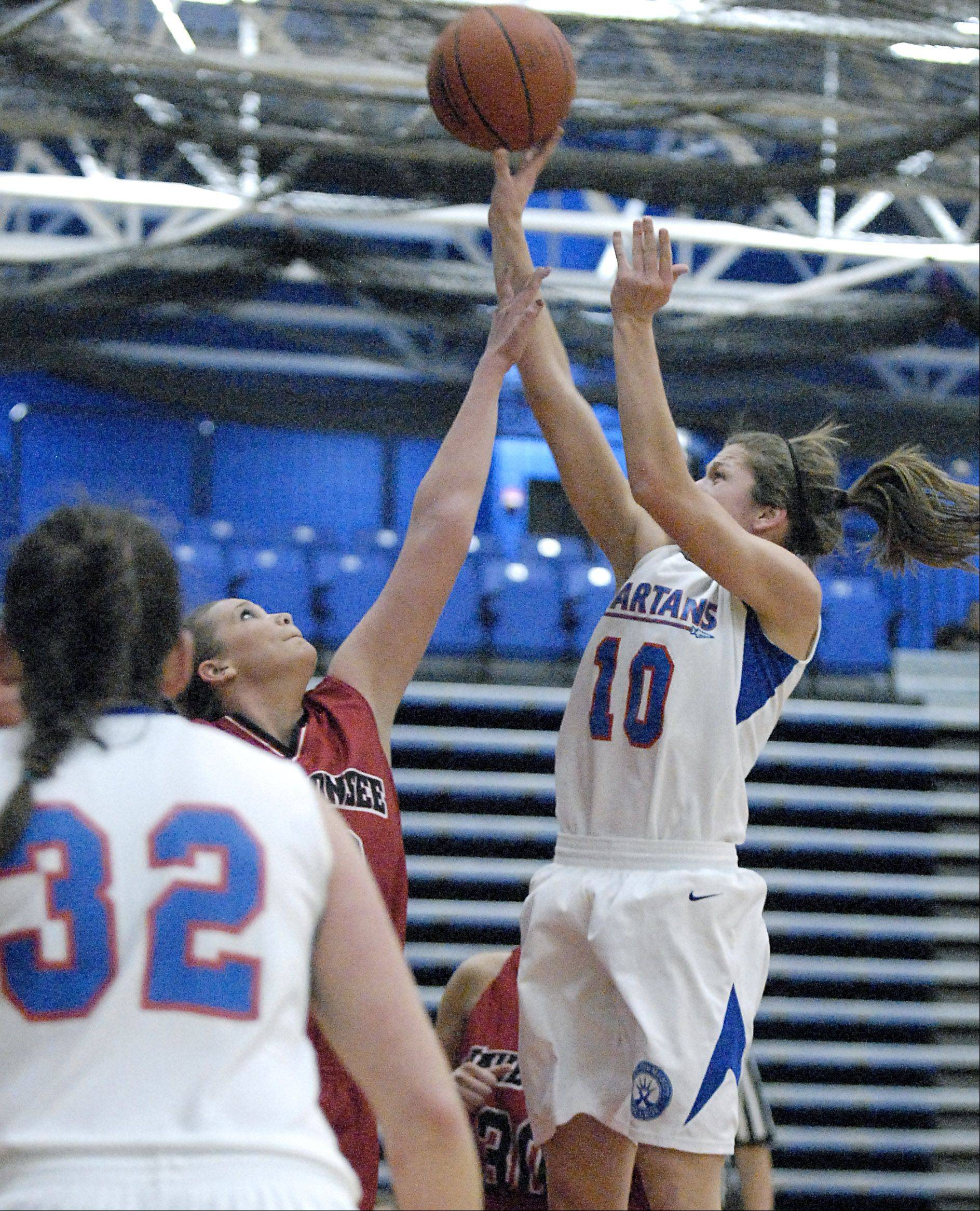 Elgin Community College's Cassie Dumoulin shoots over Waubonsee Community College's Colleen Purcell in the second half of Region IV playoffs on Thursday, March 1.