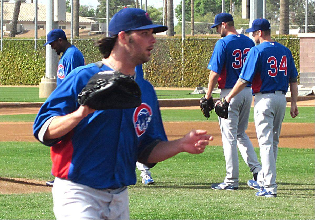 Pitcher James Russell covering first base at Cubs spring training camp at Mesa.