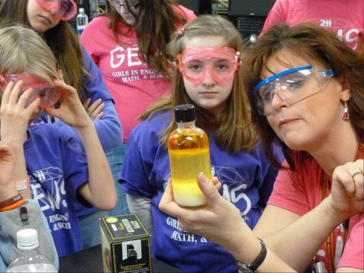 Sue Bober, a chemistry teacher at Schaumburg High School, works with girls at the GEMS conference.