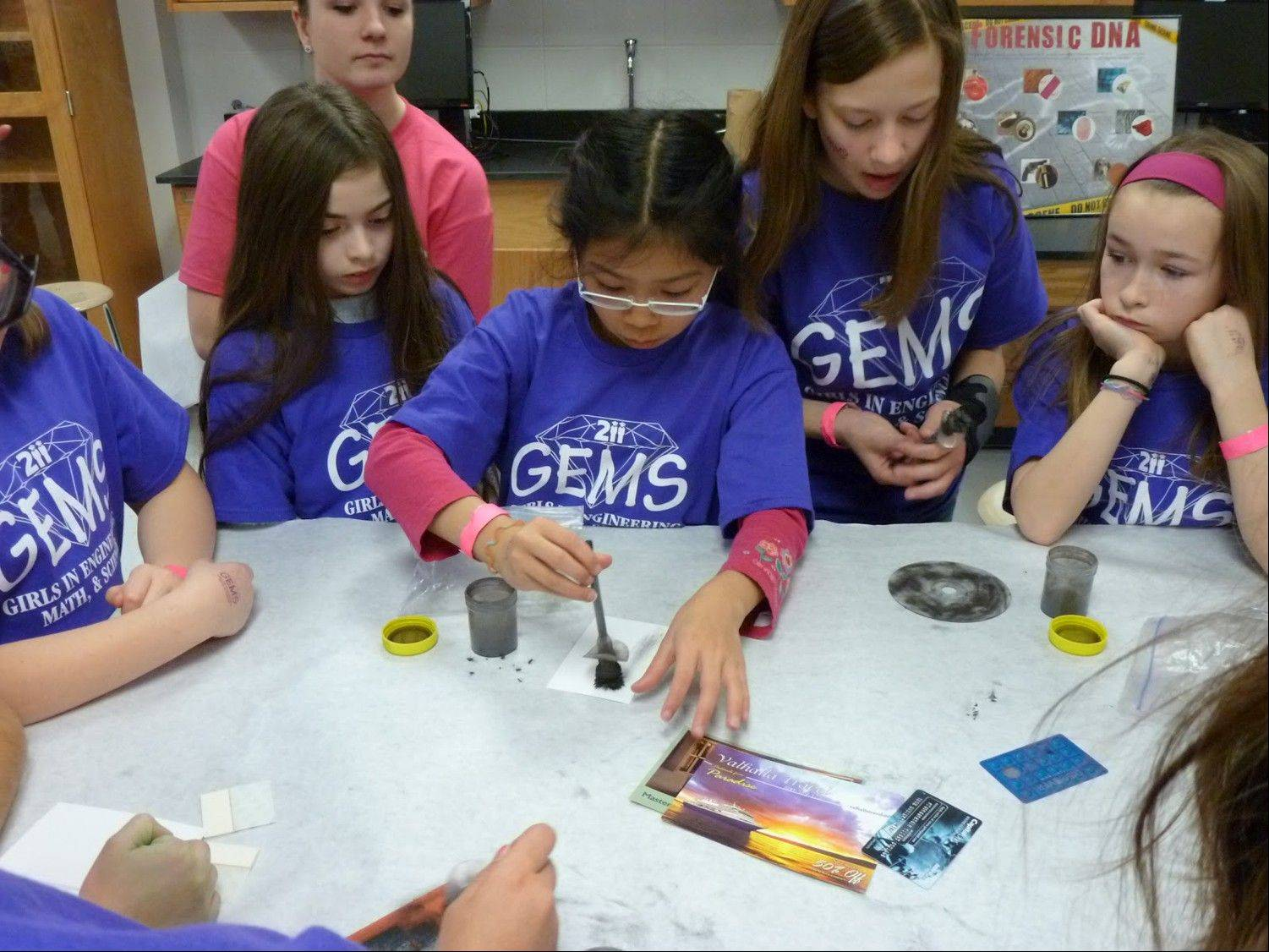 A team of girls works on a science project at the conference.