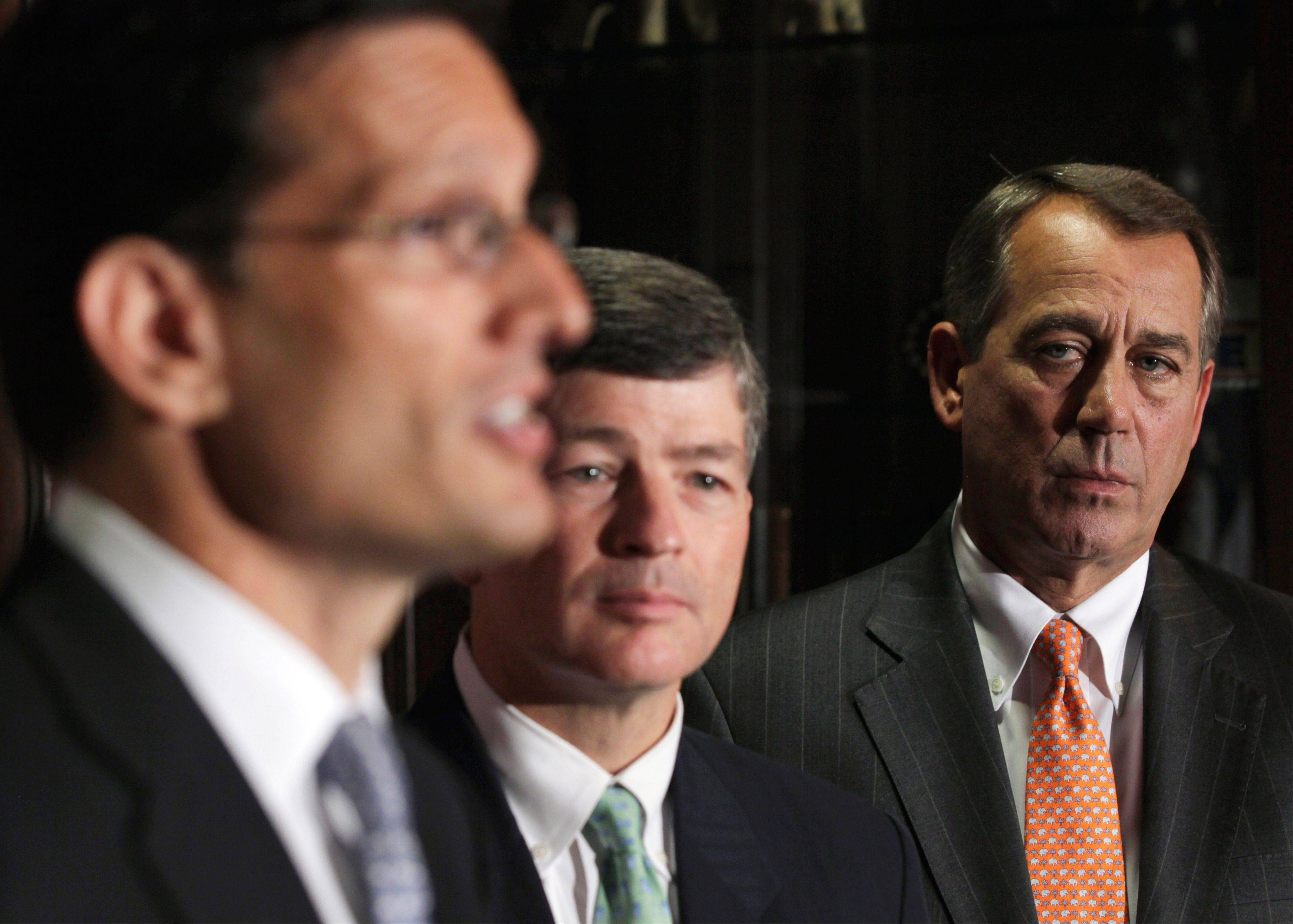 House Speaker John Boehner of Ohio, right, and Republican Conference Chairman Rep. Jeb Hensarling, R-Texas, center, listen as House Majority Leader Eric Cantor of Virginia, left, speaks during a news conference at The Republican National Committee on Capitol Hill in Washington.