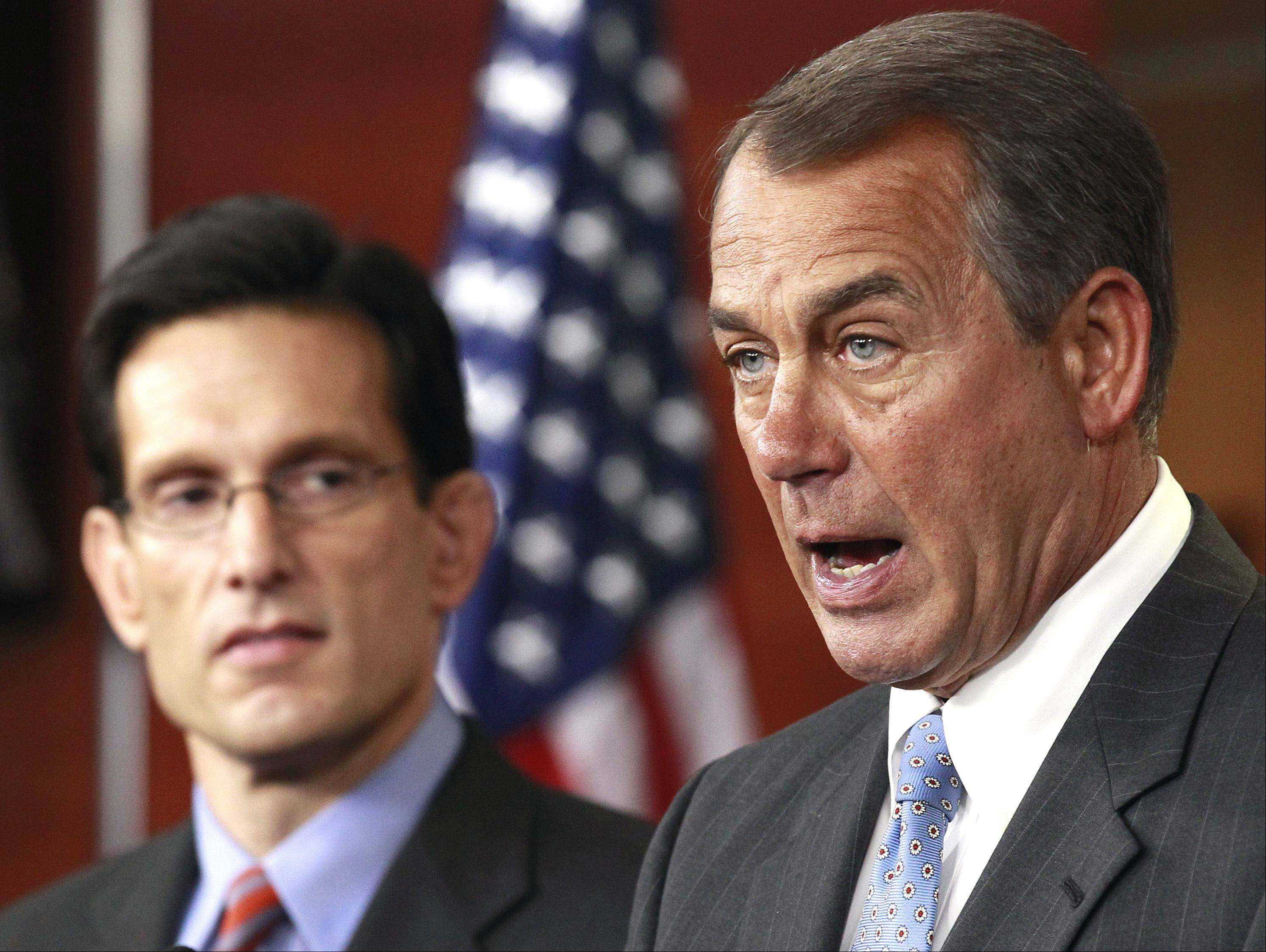 House Speaker John Boehner of Ohio, right, accompanied by House Majority Leader Eric Cantor of Virginia., speaks to reporters on Capitol Hill.