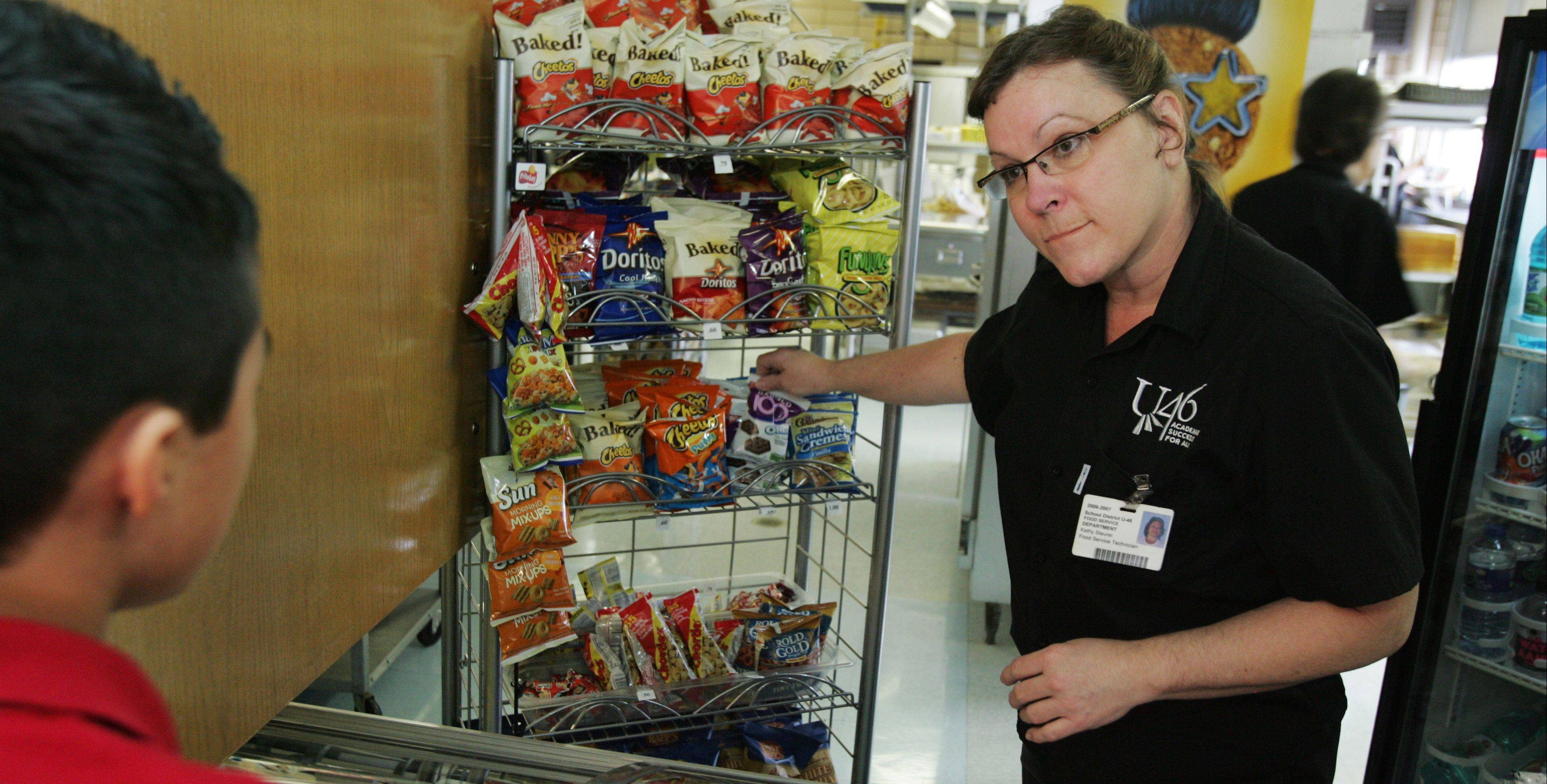 Steurer works the snack window in the school cafeteria where she rotates daily through different duties along with other food service workers.