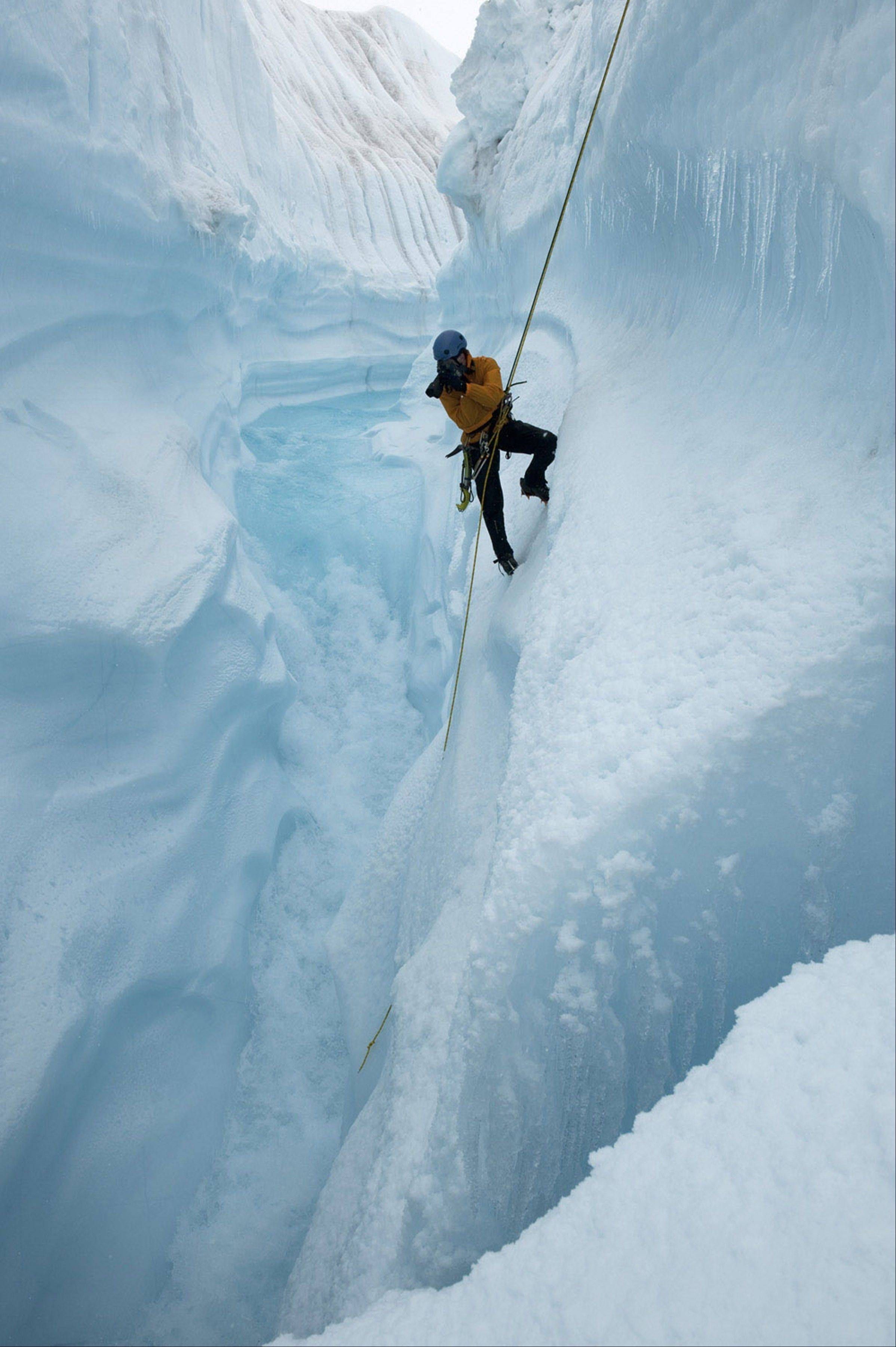 James Balog, a scientist and nature photographer, rappels into Survey Canyon through the Greenland Ice Sheet.