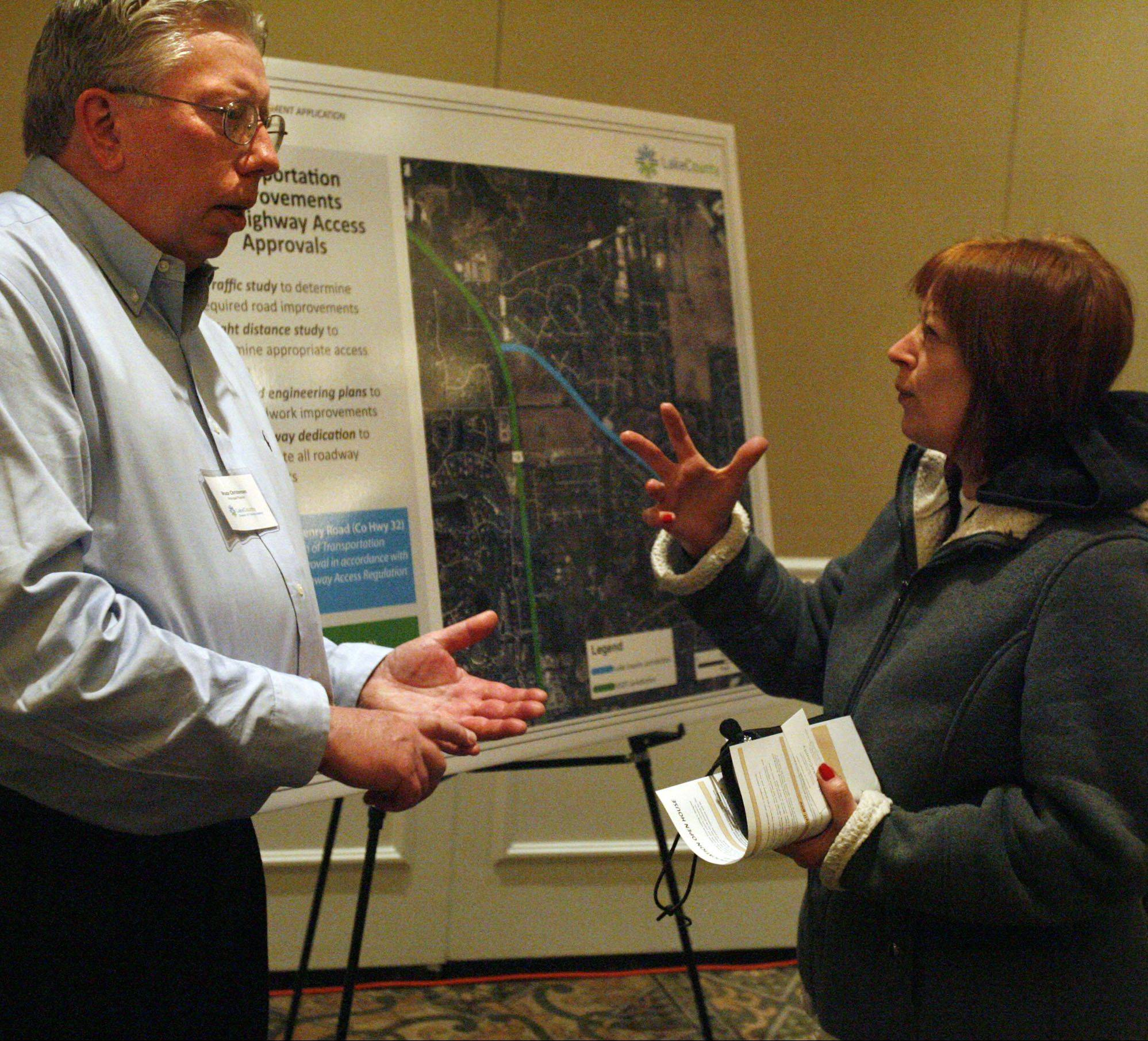 Karen Sande of Kildeer discusses development of a shopping mall with Lake County planner Bruce Christensen at a Saturday open house.
