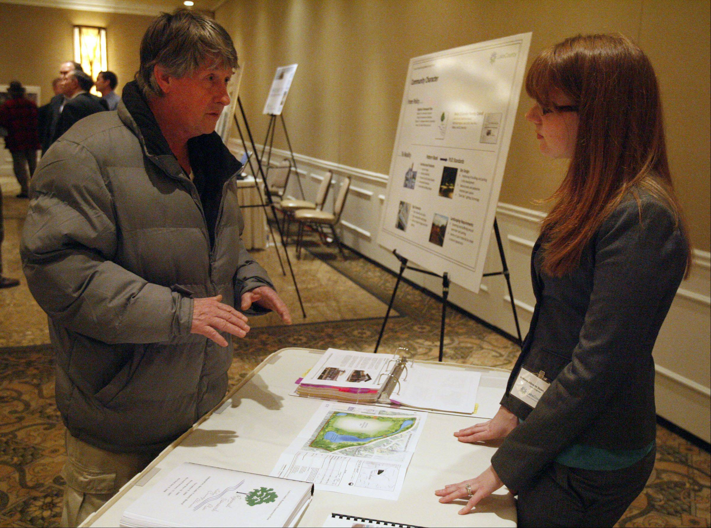 George Leclaire/gleclaire@dailyherald.comResident Frank Houlihan talks with Lake County engineer Brittany Albrecht at a Saturday open house on rezoning the Dimucci family property at Rand and Old McHenry roads.