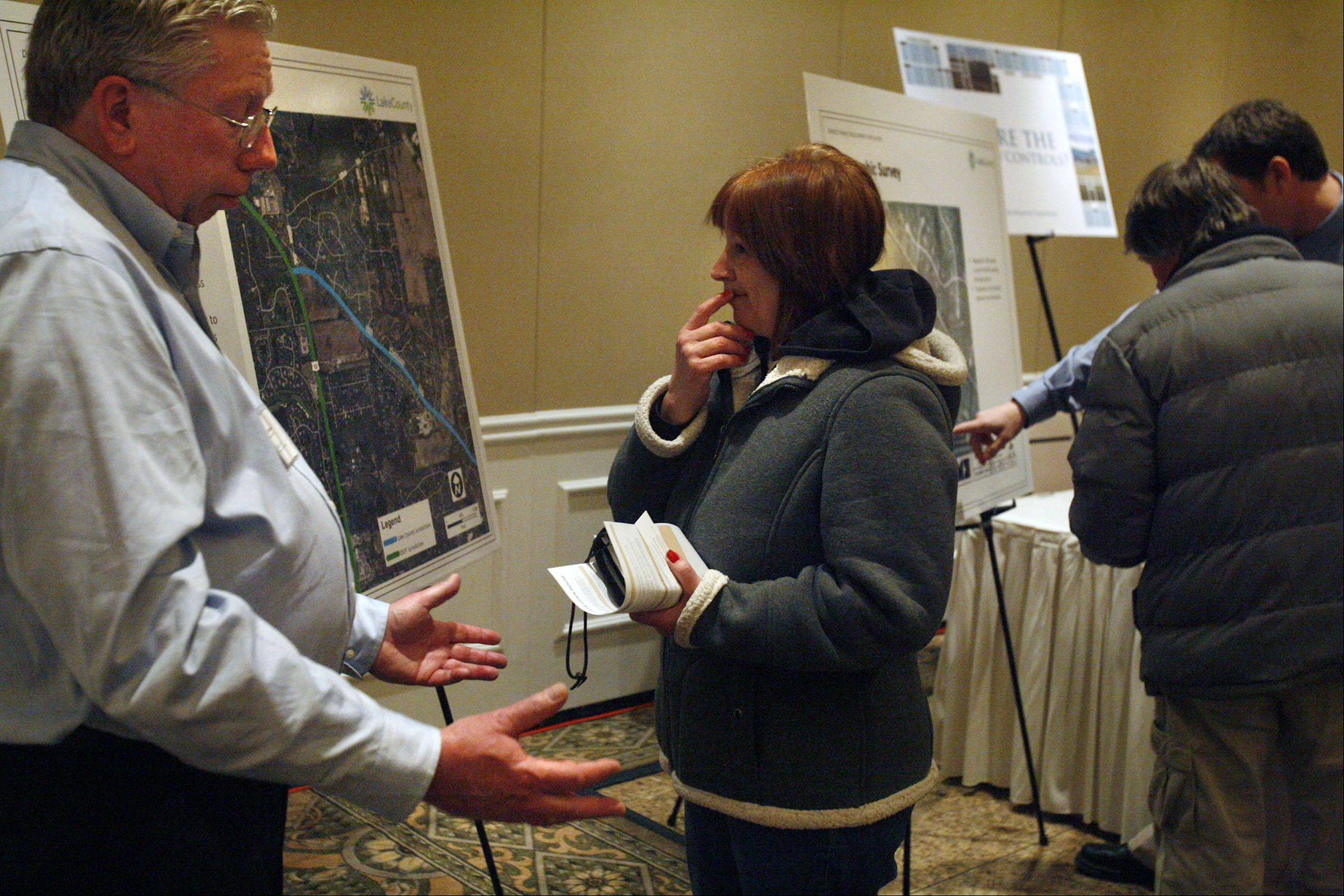 George Leclaire/gleclaire@dailyherald.comKaren Sande of Kildeer discusses development of a shopping mall with Lake County planner Bruce Christensen at a Saturday open house.