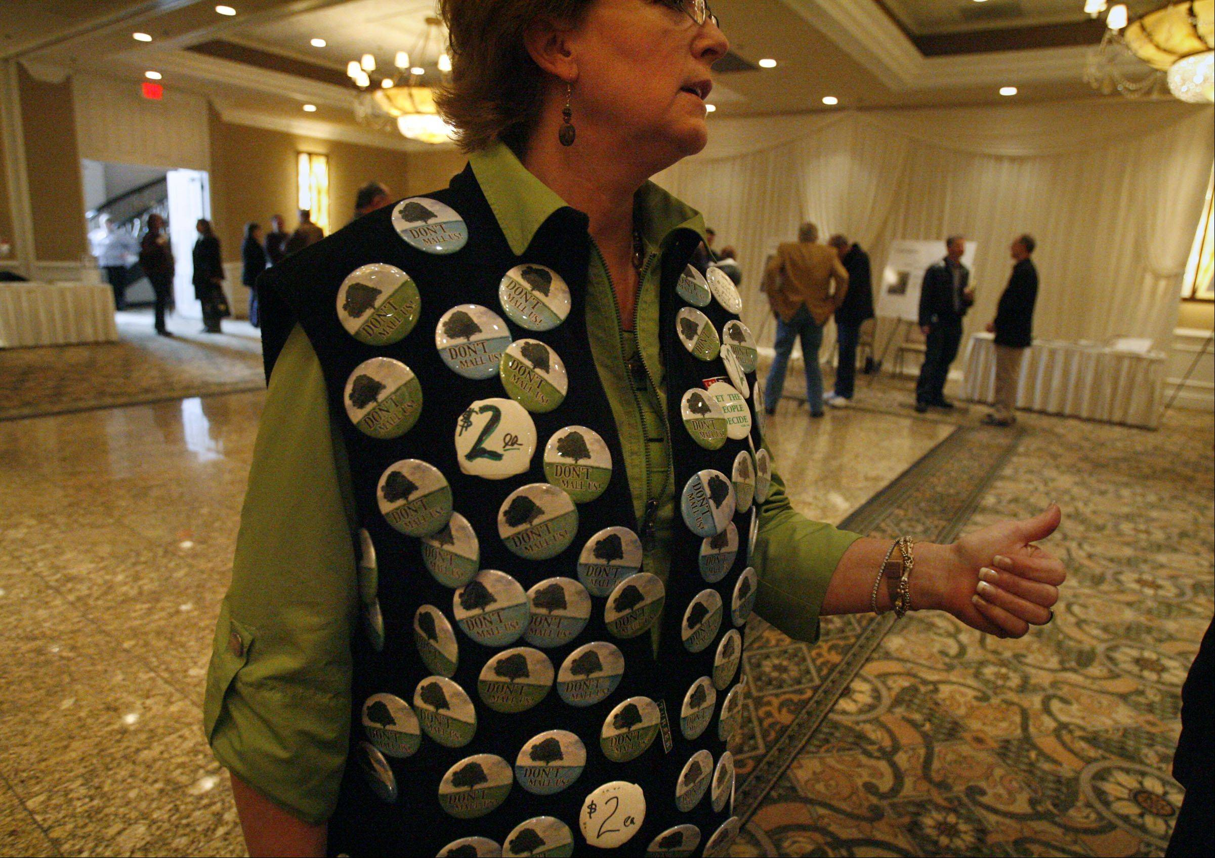 "George Leclaire/gleclaire@dailyherald.com""Don't Mall Us"" buttons were on sale Saturday during an open house concerning rezoning a residential property at Rand and Old McHenry roads to commercial use."