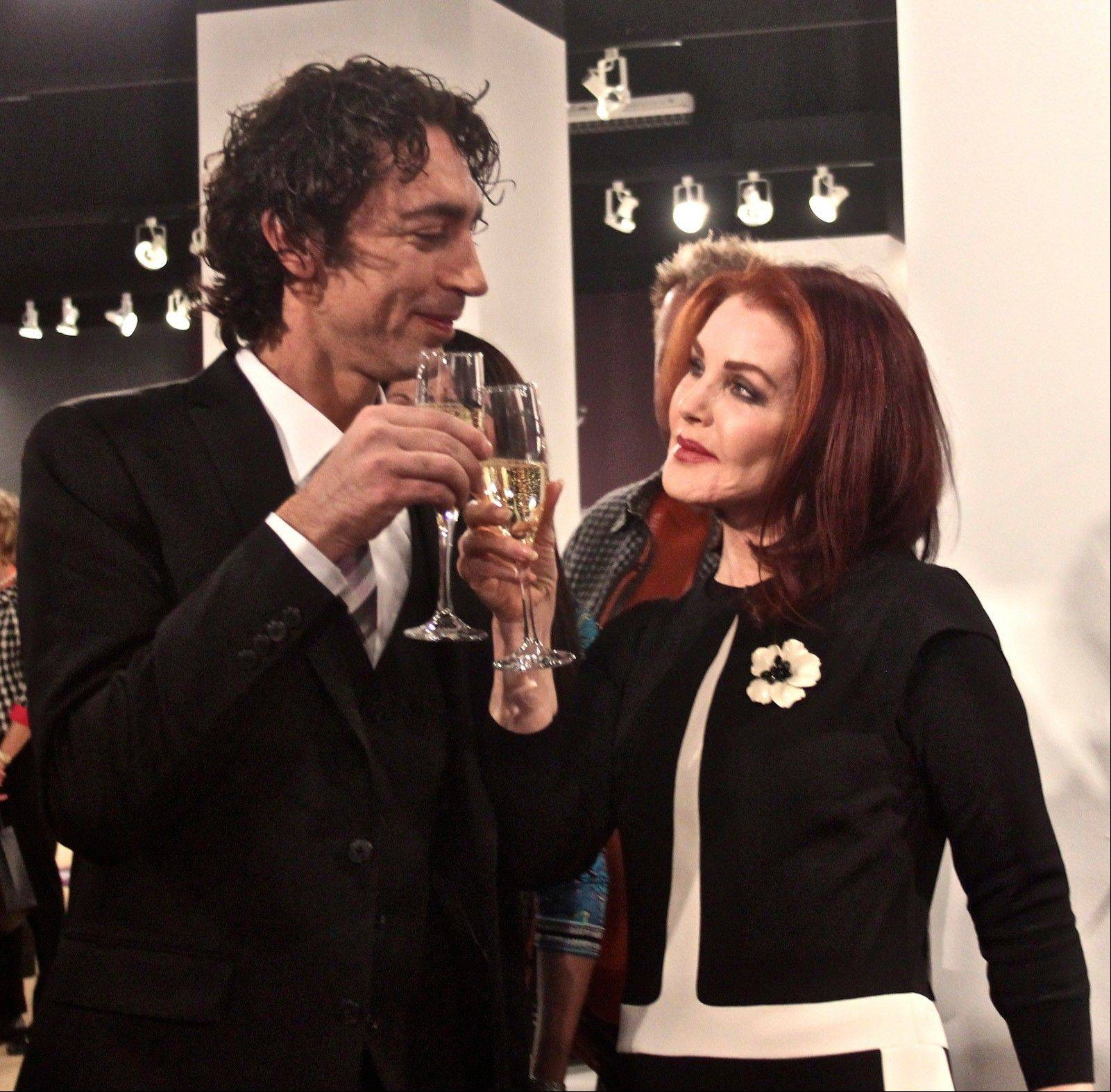 Shlomi Haziza and Priscilla Presley toast her new collection of home furnishings and accessories.
